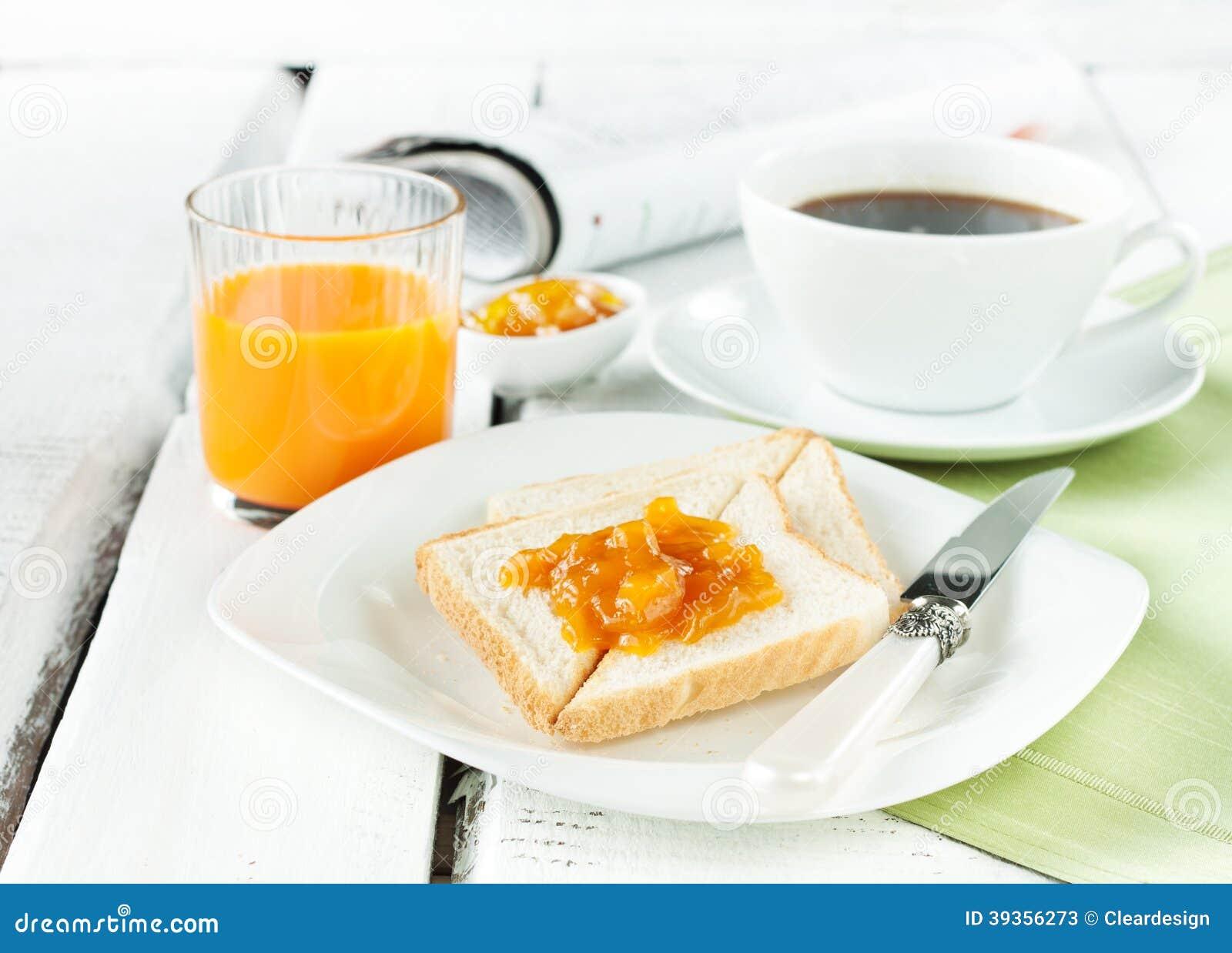 Petit déjeuner continental - café, jus d orange, pain grillé