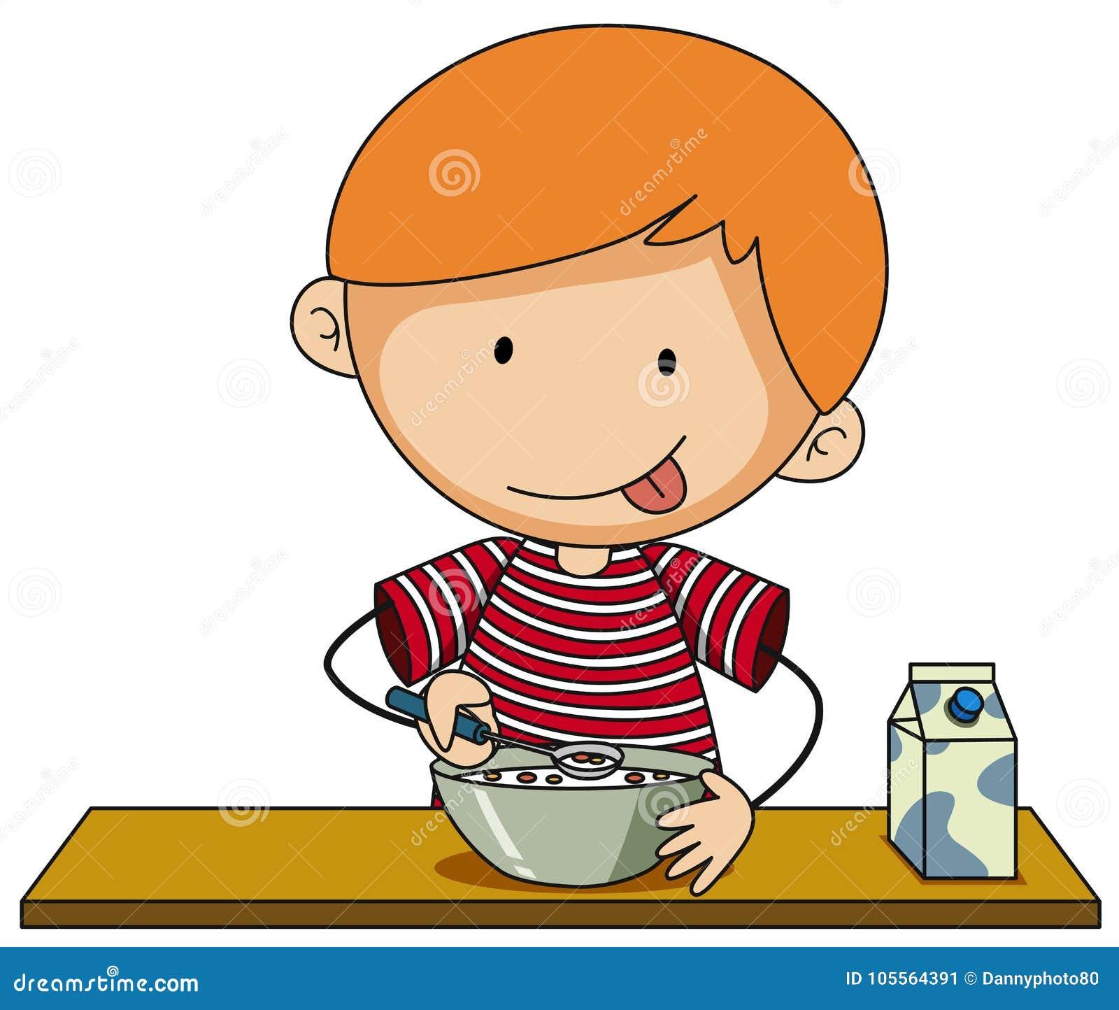 Petit garçon ayant la céréale avec du lait