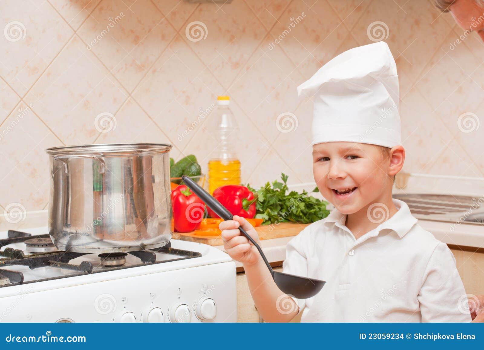 petit gar on sur la cuisine images stock image 23059234. Black Bedroom Furniture Sets. Home Design Ideas