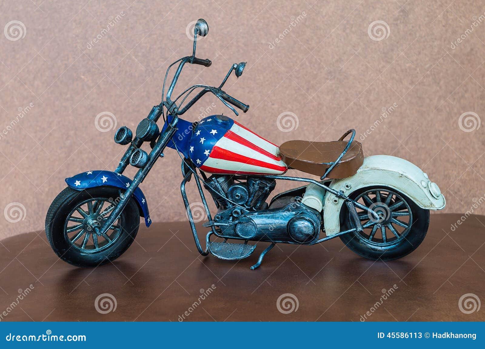 petite moto de jouet photo stock image 45586113. Black Bedroom Furniture Sets. Home Design Ideas