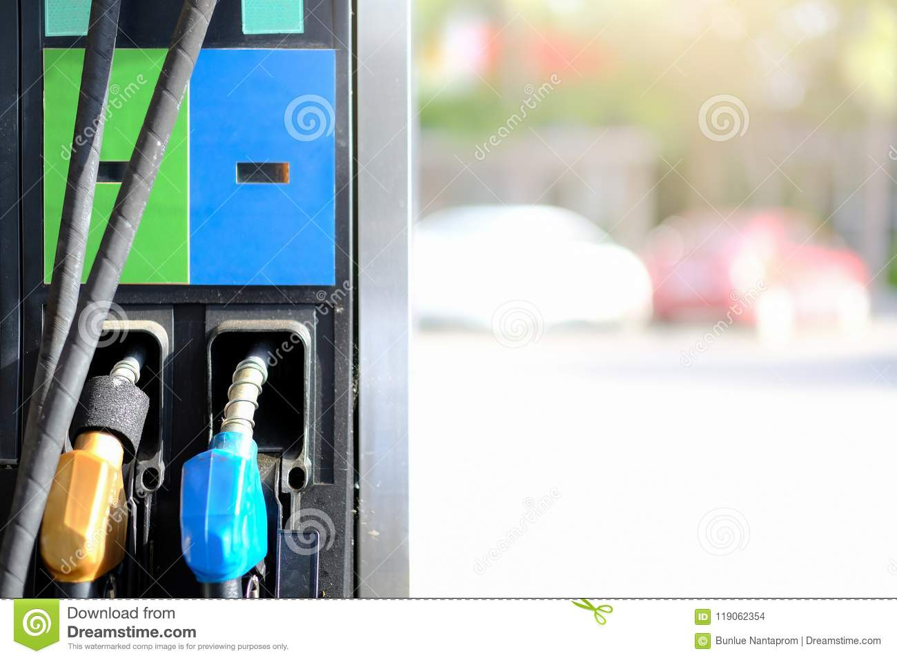Petrol pump filling nozzles background , Gas station in a service, transport and business concept