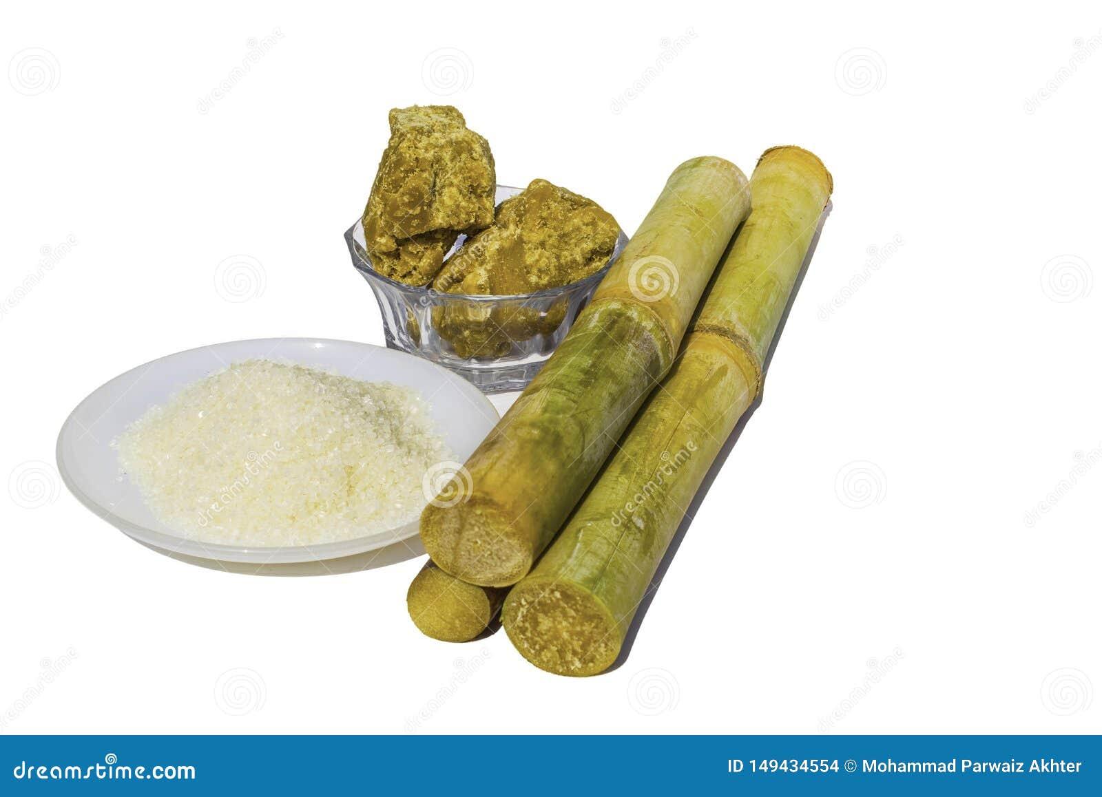 Pezzi di canna da zucchero con zucchero bianco