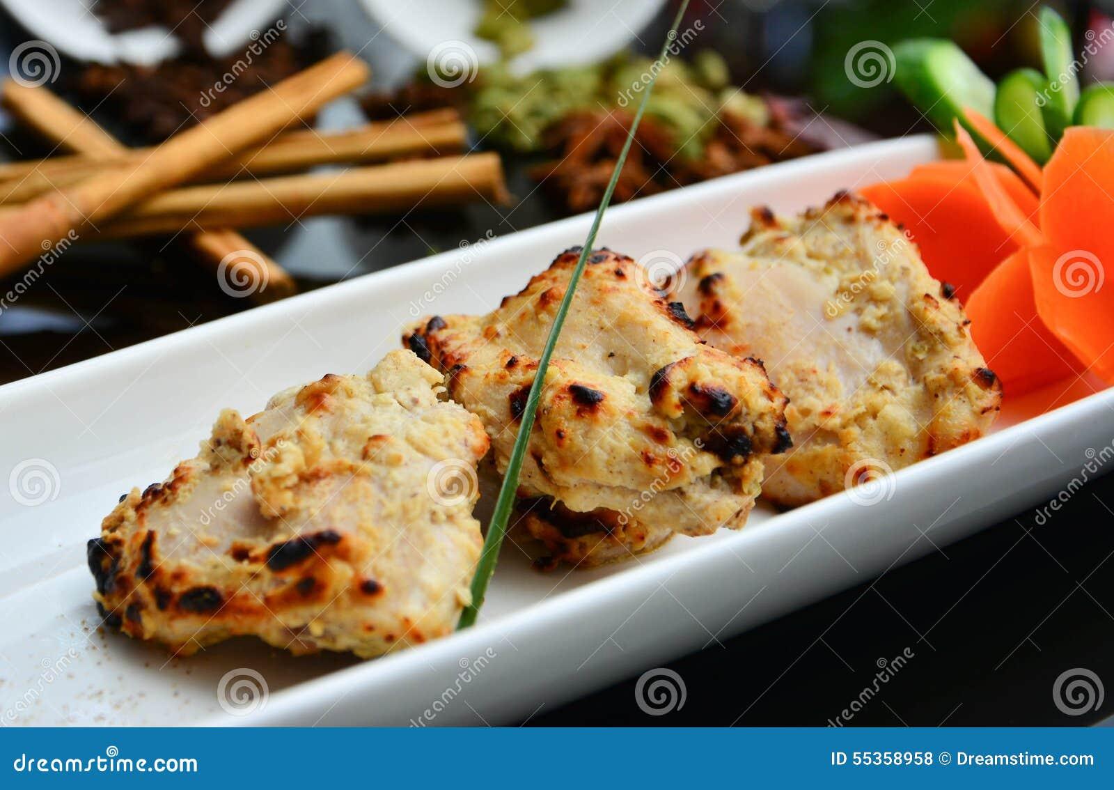 Pezzi indiani del pollo