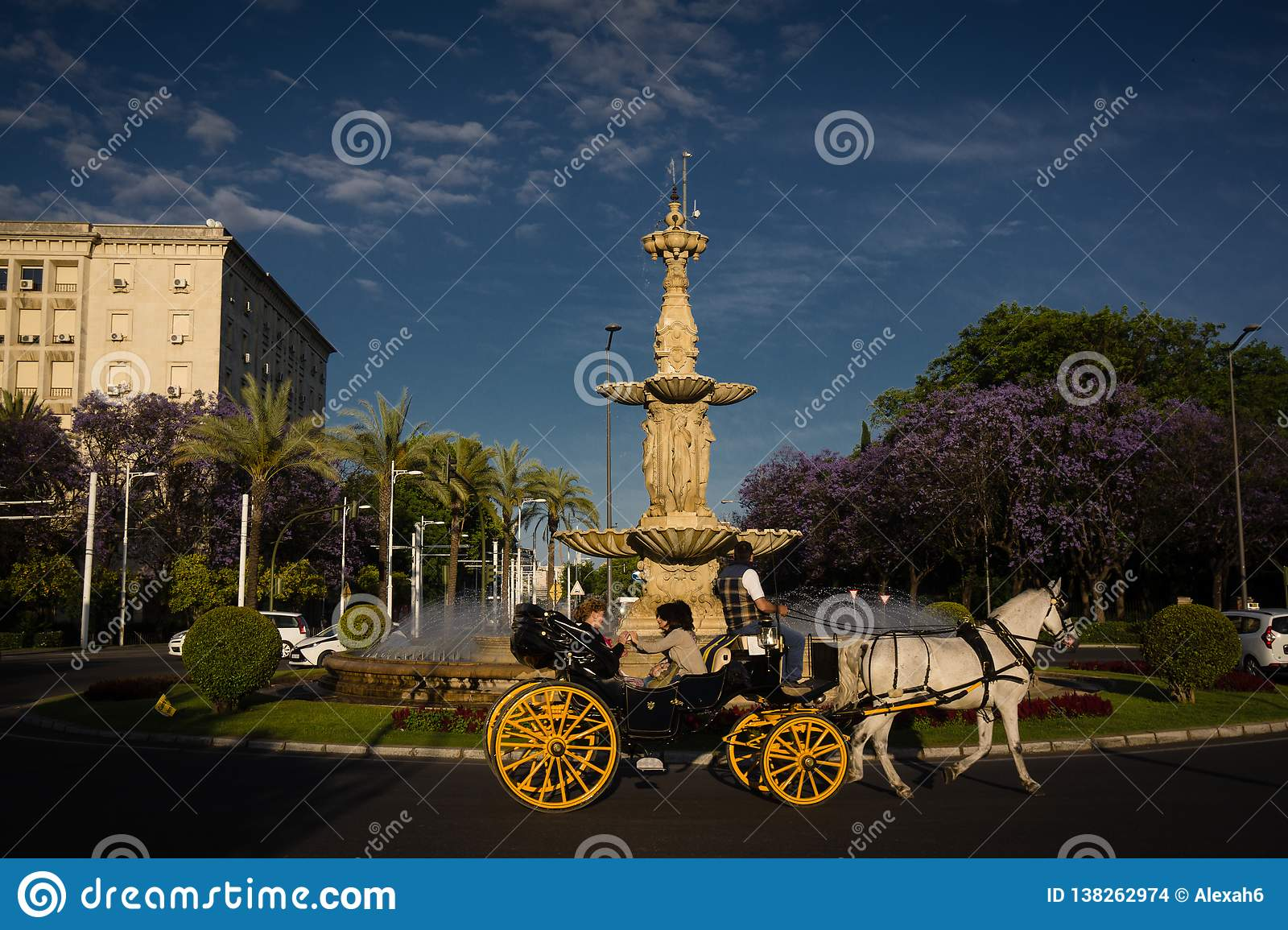 Spain Andalucia horse-drawn carriage in Seville traffic