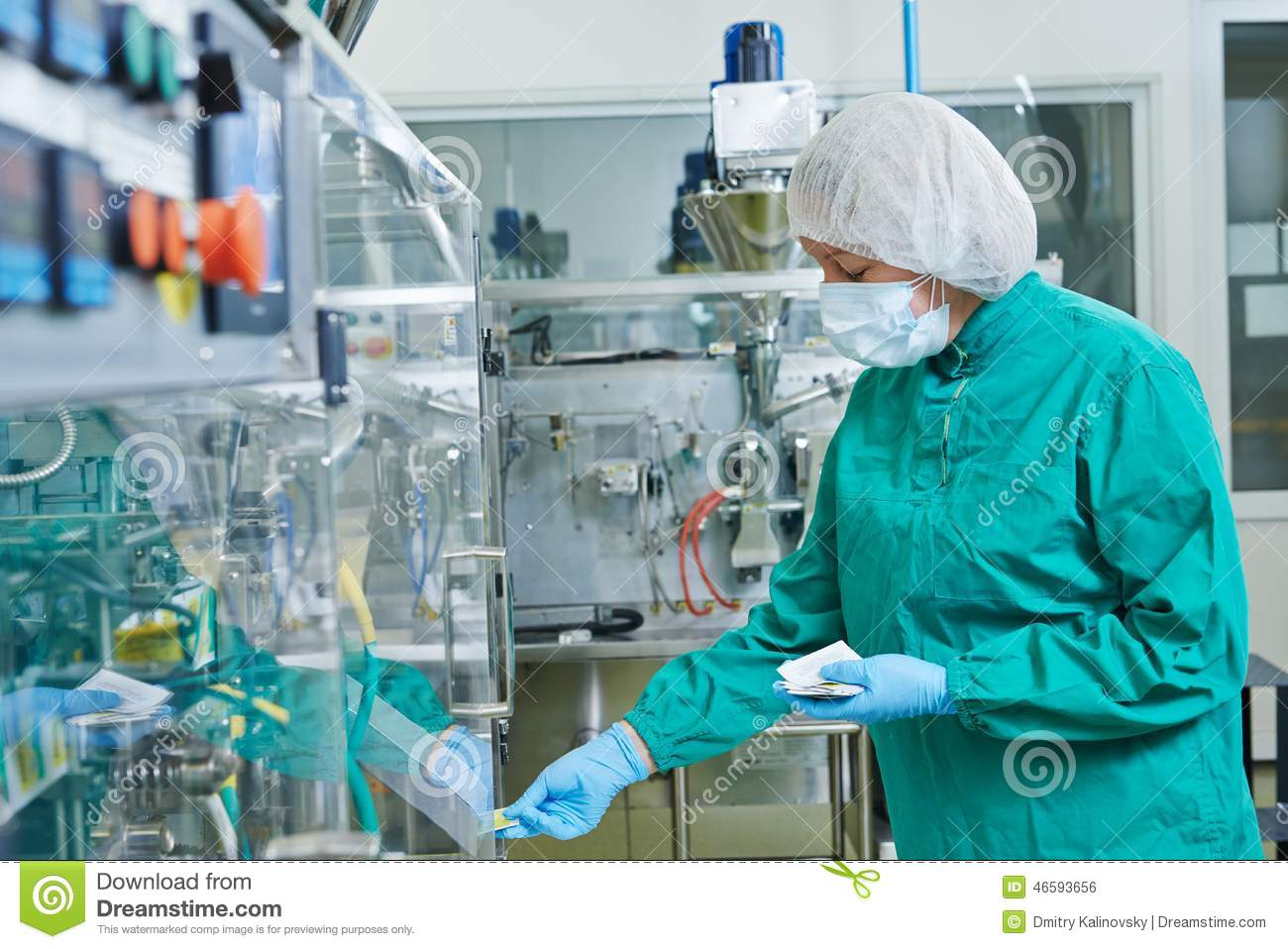 Pharmaceutical factory woman worker operating production line at ...