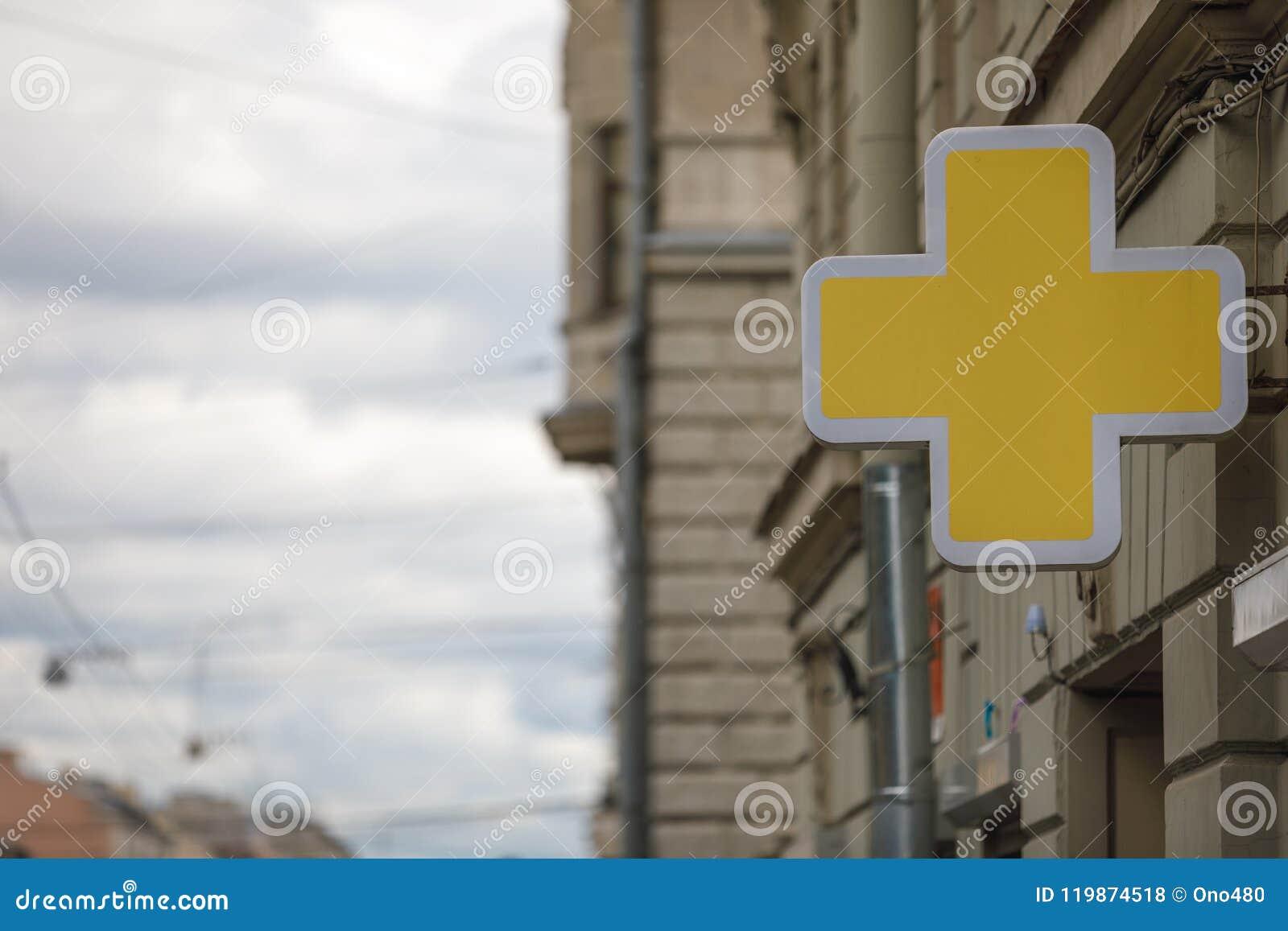 Pharmacie croisée de jaune de symbole de chimie