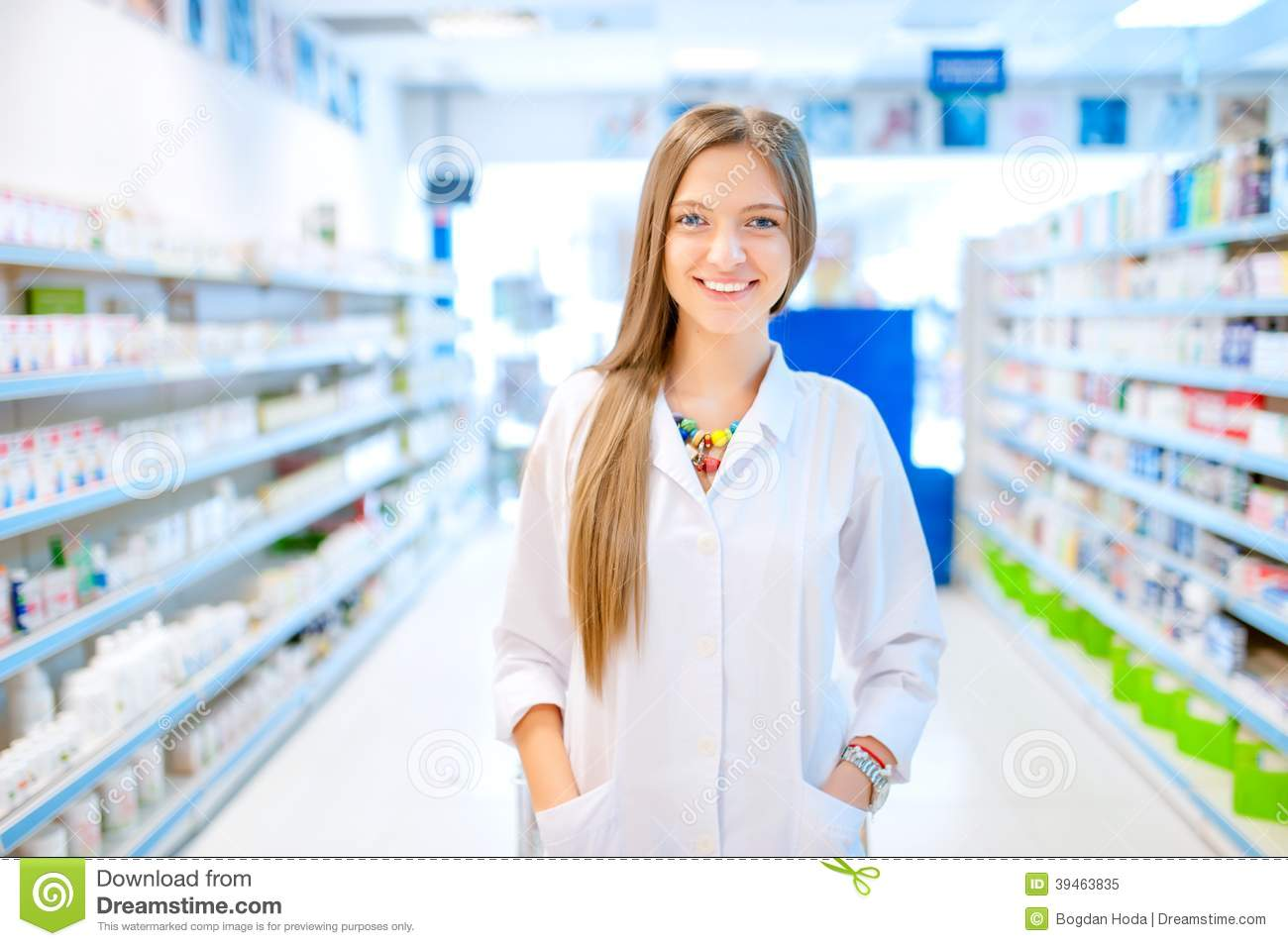 Pharmacist chemist woman standing in pharmacy