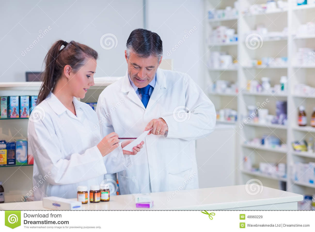 pharmacist and his trainee working together - Pharmacist Trainee