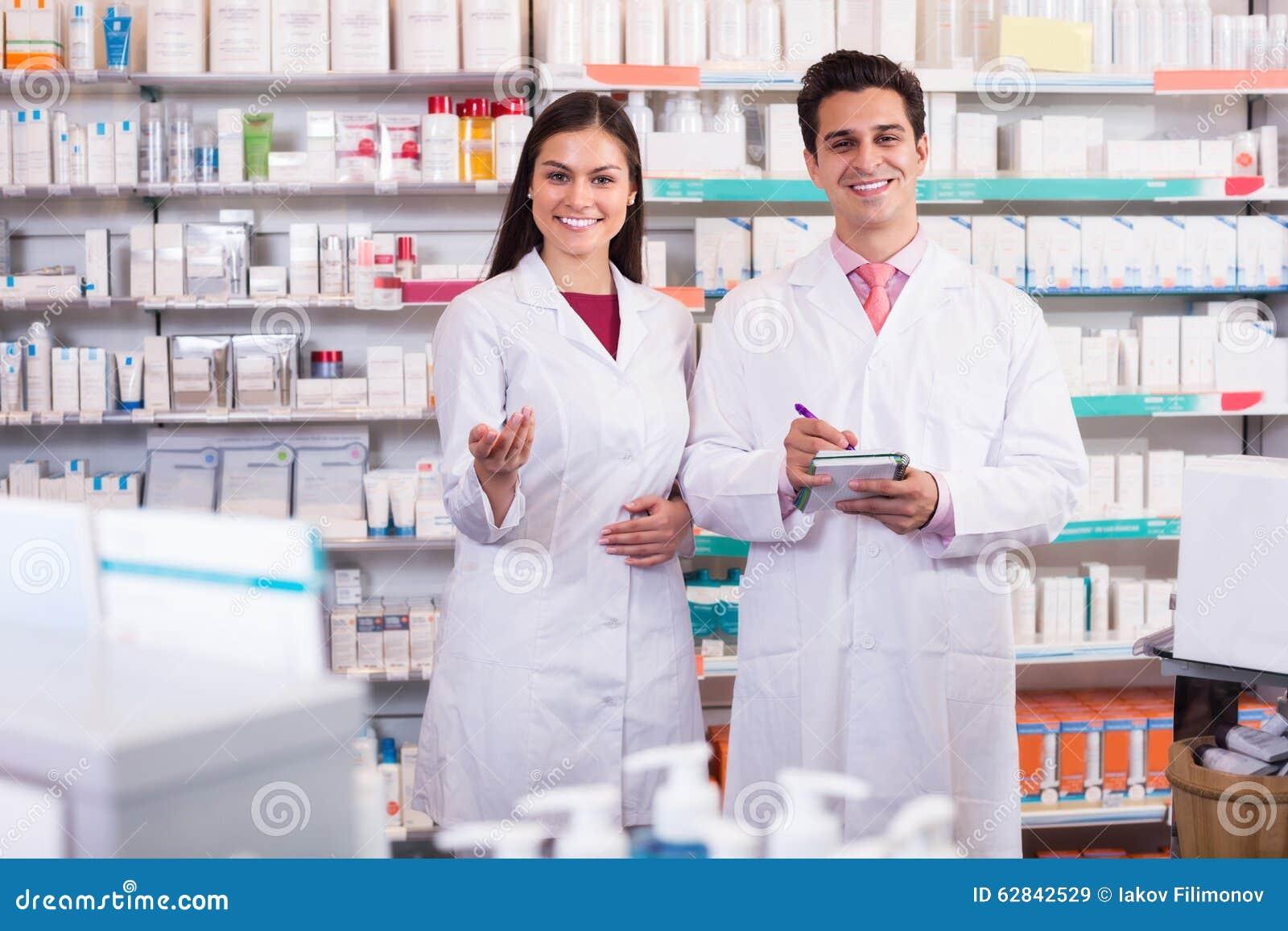Pharmacist and pharmacy technician working