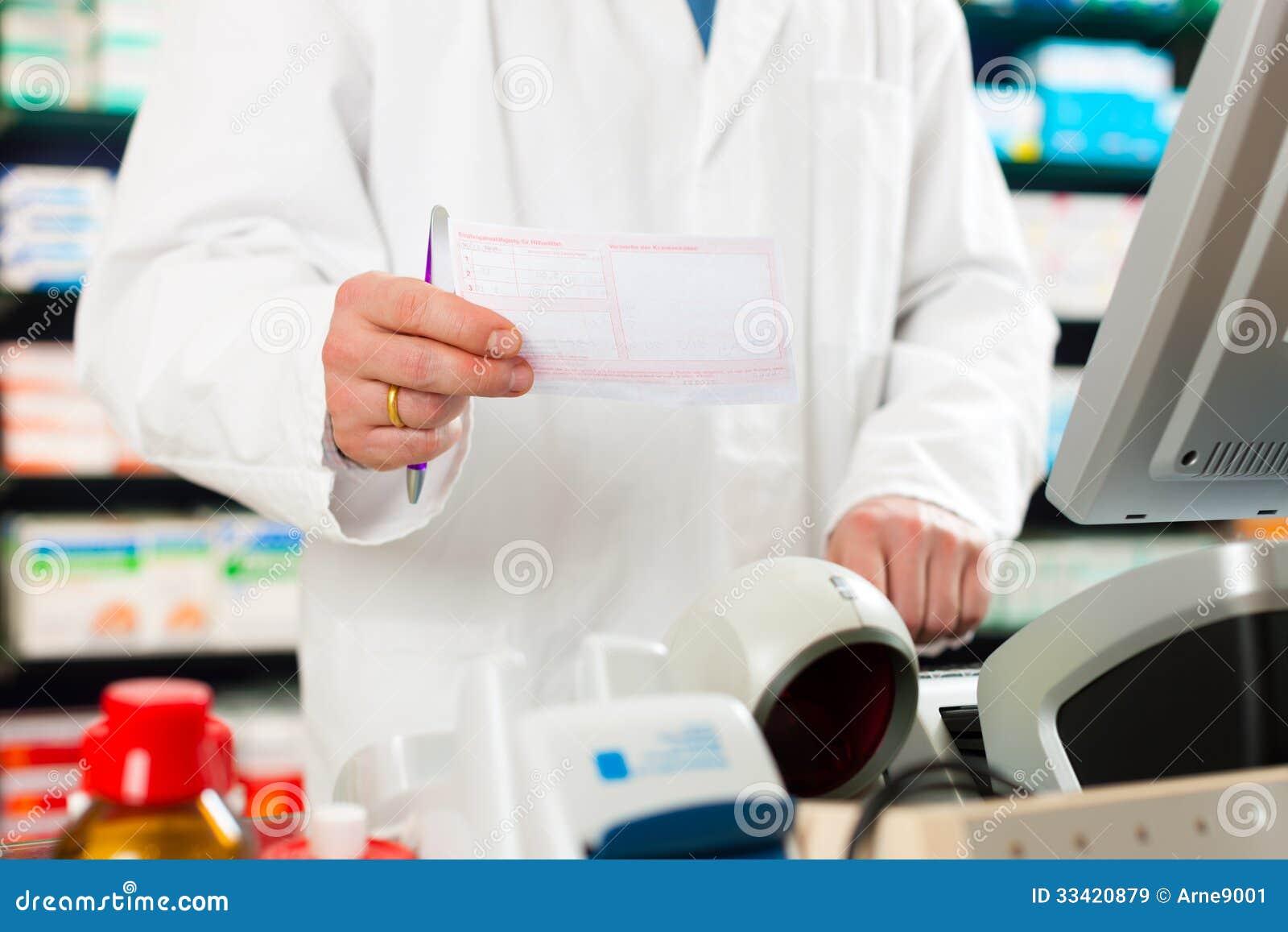 pharmacist prescription slip in pharmacy royalty free