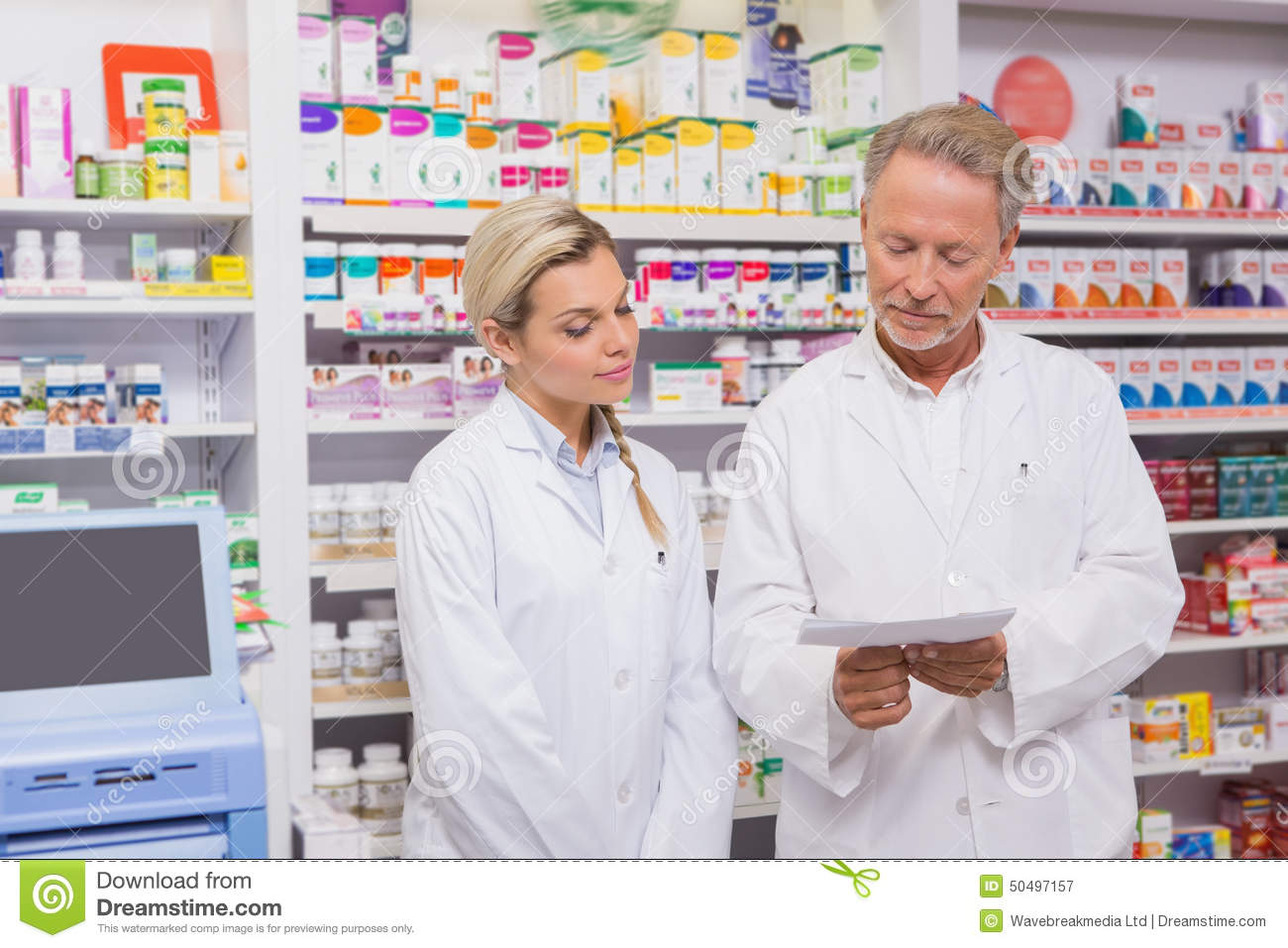 pharmacist and trainee talking together about prescription - Pharmacist Trainee