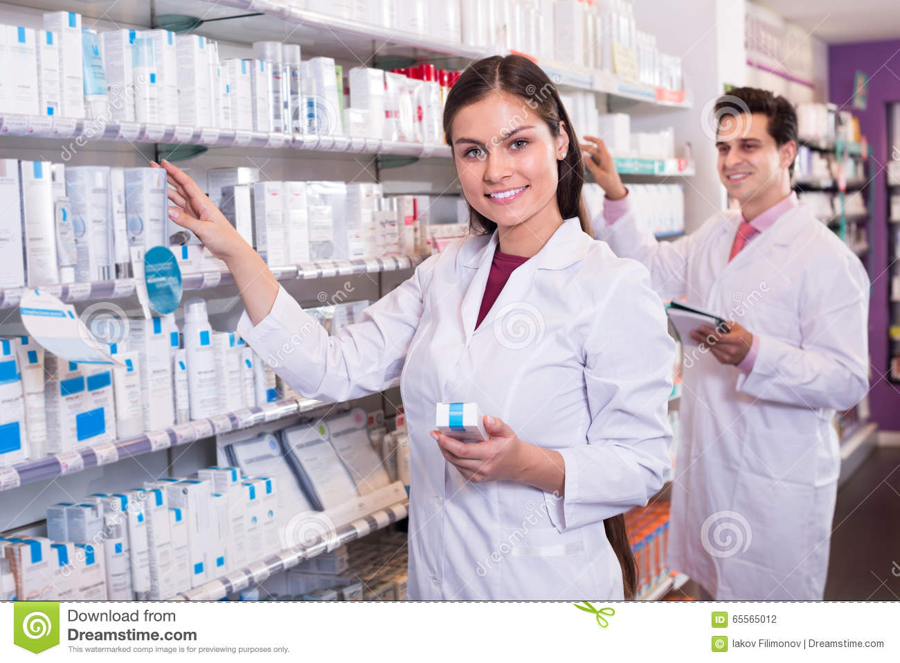 Pharmacists Posing In Drugstore Royalty Free Stock Image