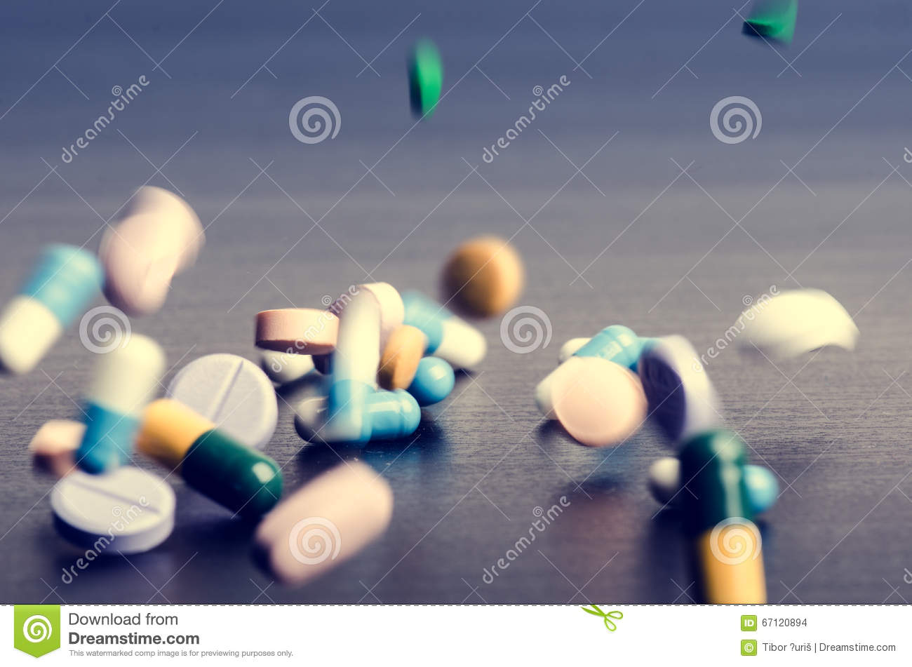 Pharmacy background on a dark table. Levitation pills. Tablets on a dark background which falling down. Pills.Medicine and health