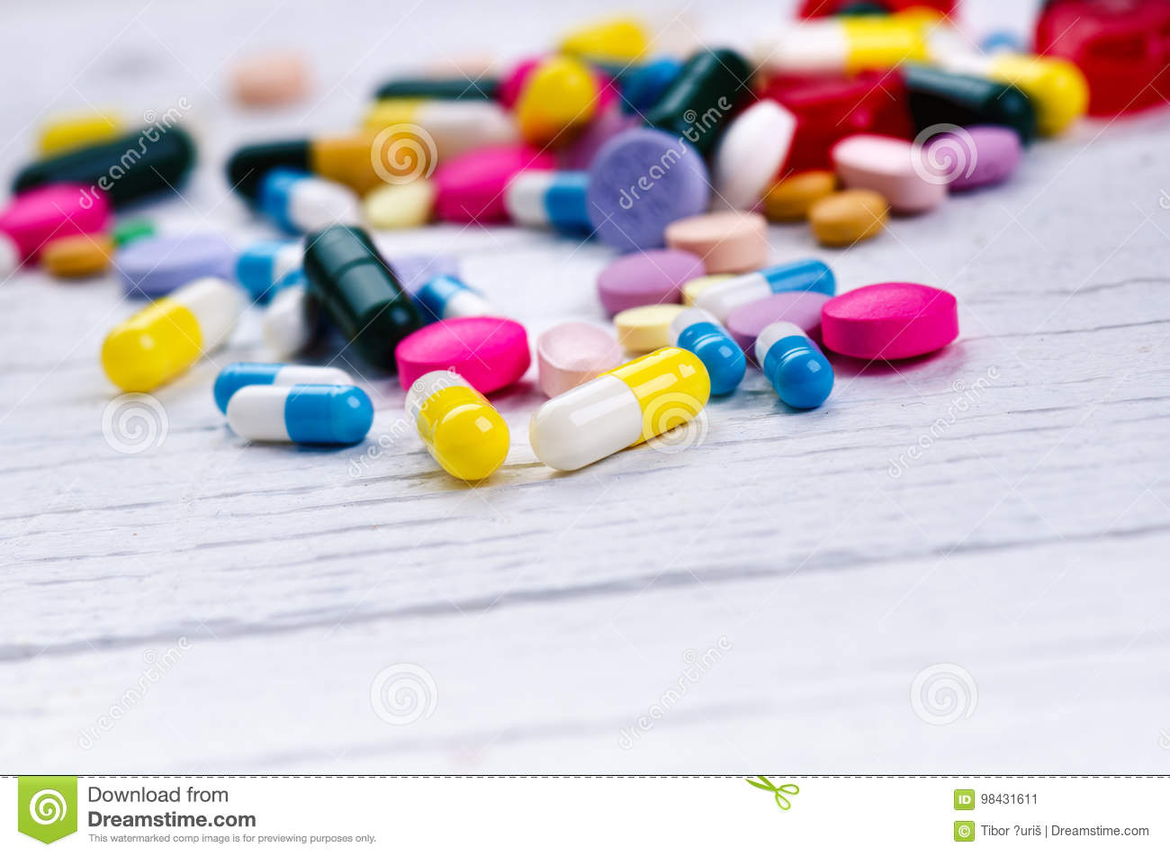 Pharmacy background on a white table. Tablets on a white background. Pills. Medicine and healthy. Close up of capsules. Differend
