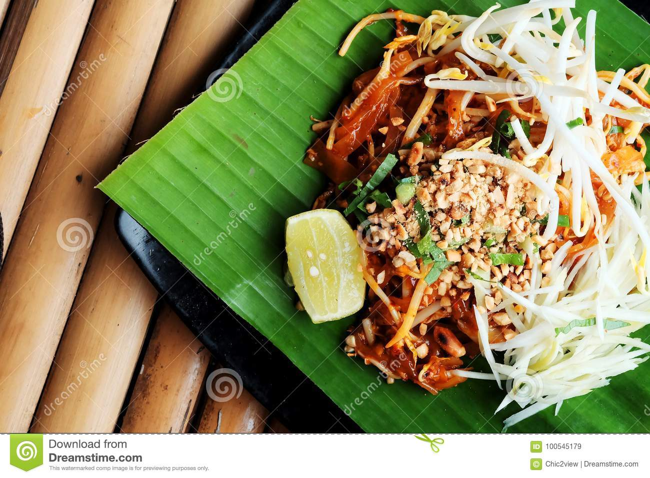 Phat thaior Pad thai is a famous Thailand tradition cuisine with fried noodle served on banana leaf