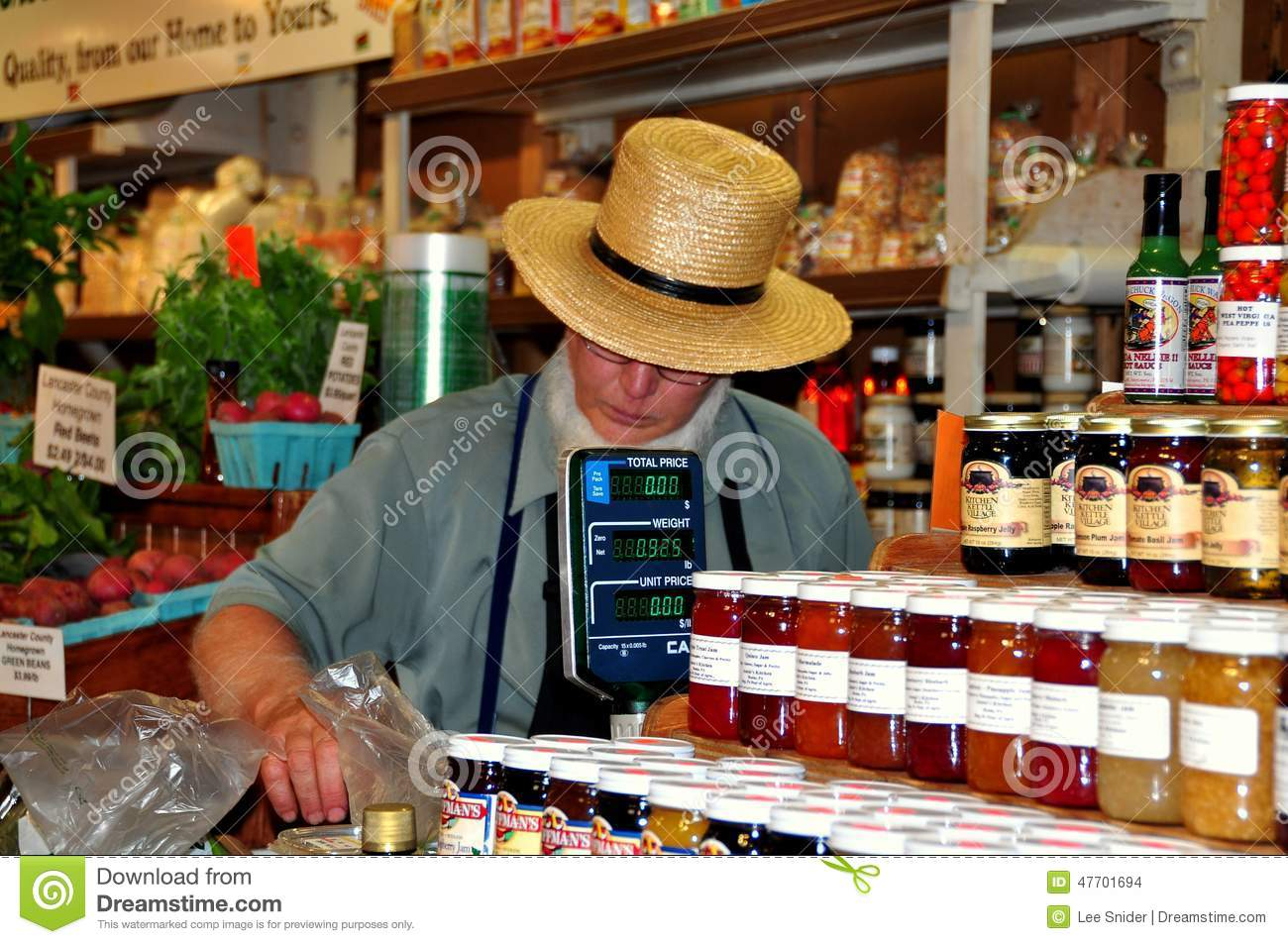 f99b6dea PHILADELPHIA, PENNSYLVANIA: Amish man with white beard and straw hat  selling top quality foods at Kaufman's Farm Products booth in the Reading  Terminal ...