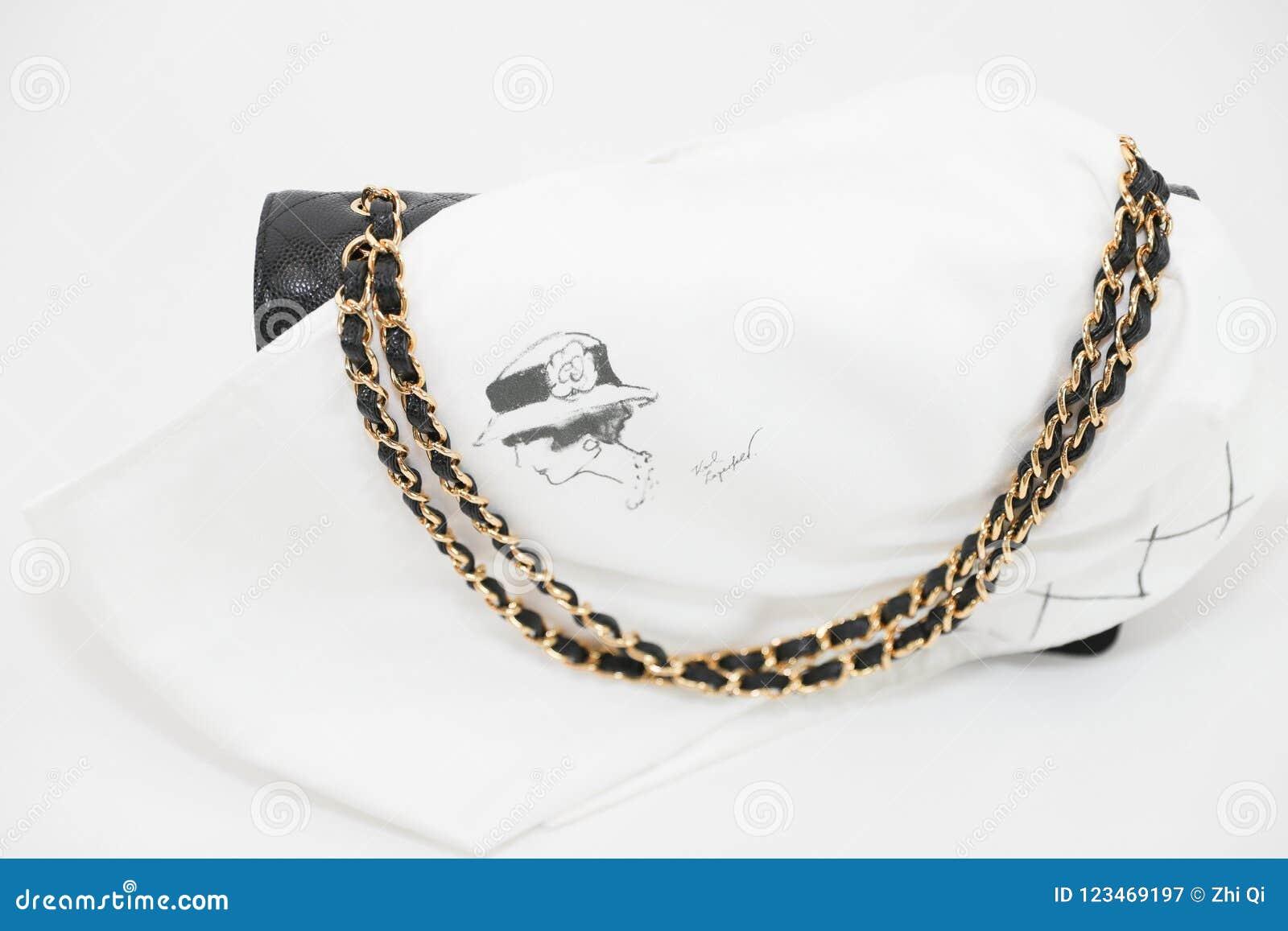 7586b94b10e7 Philadelphia, Pennsylvania, USA, August 10, 2018: Photo of black Chanel  handbag with Chanel dust bag brand Editorial on white background.