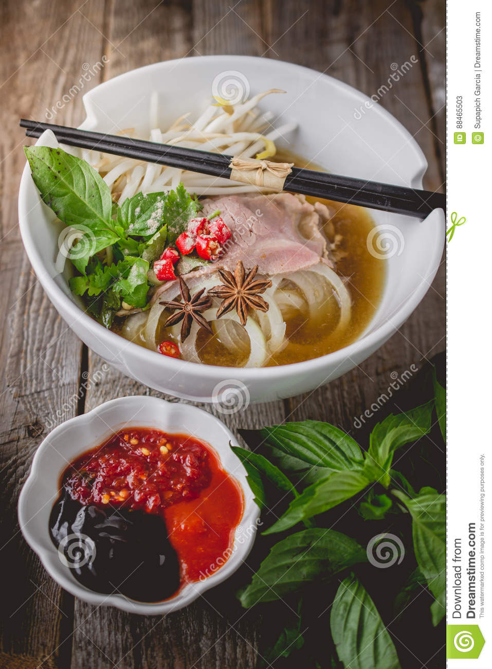 Pho Vietnamse Noodle Soup on Old Wood. Image for Food Advertise