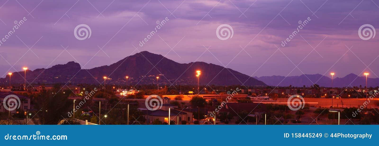 Phoenix, Arizona, USA cityscape at night with famous Camelback Mountain.