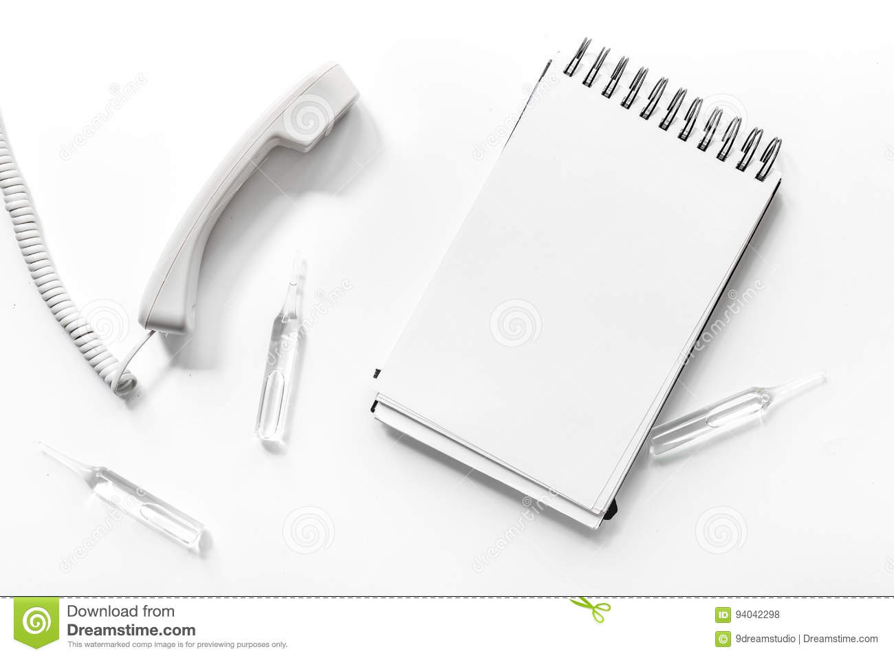 Phone Handset With Notebook On White Background Top View ...