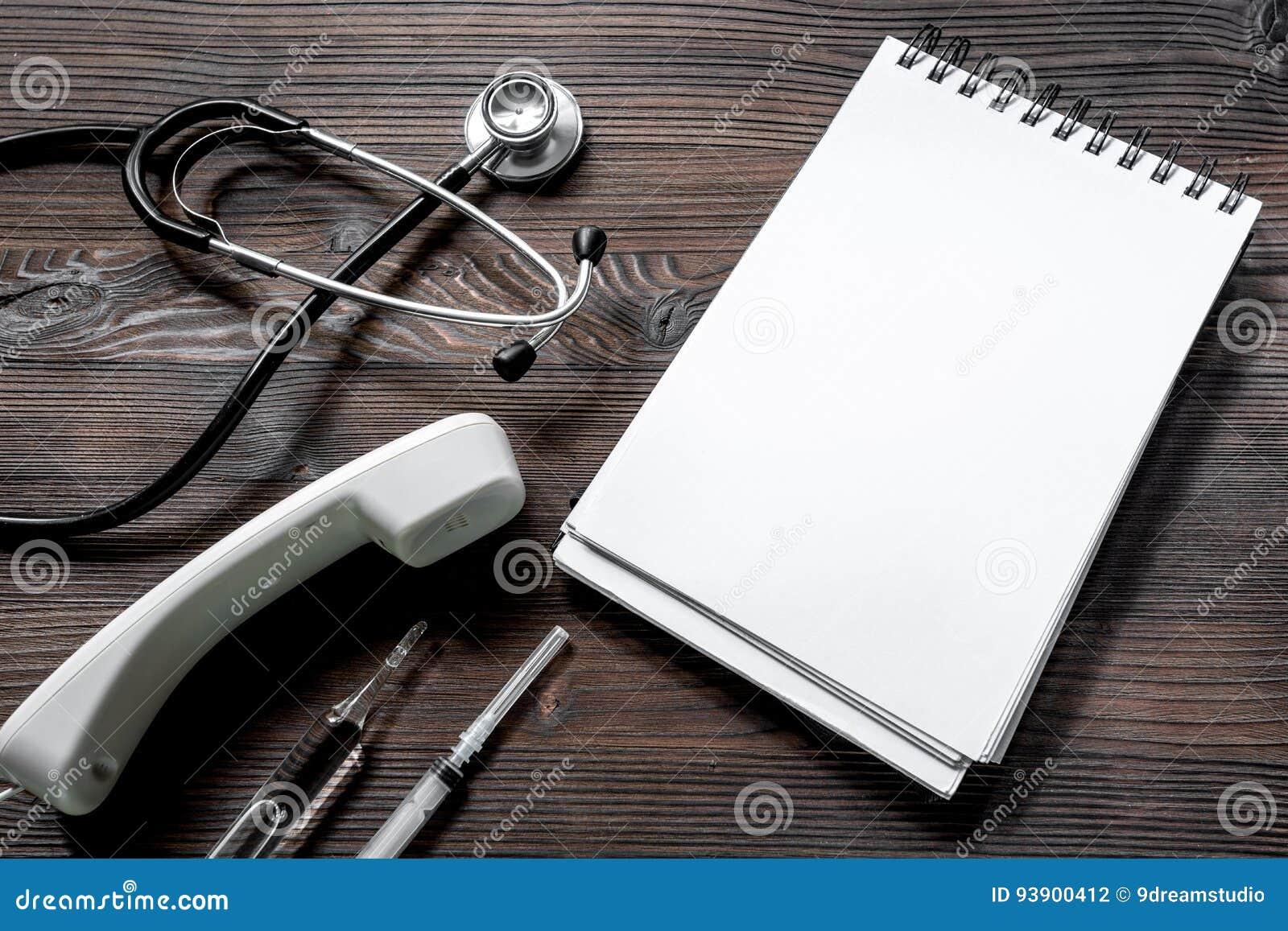 Phone Handset, Phonendoscope, Syringe, Ampoule And Notebook On ...