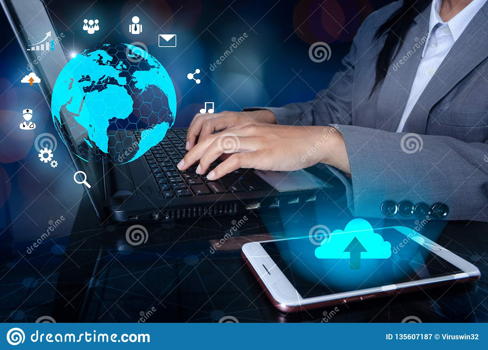 The phone has a cloud icon. Press enter button on the computer. business logistics Communication network World map send message Co