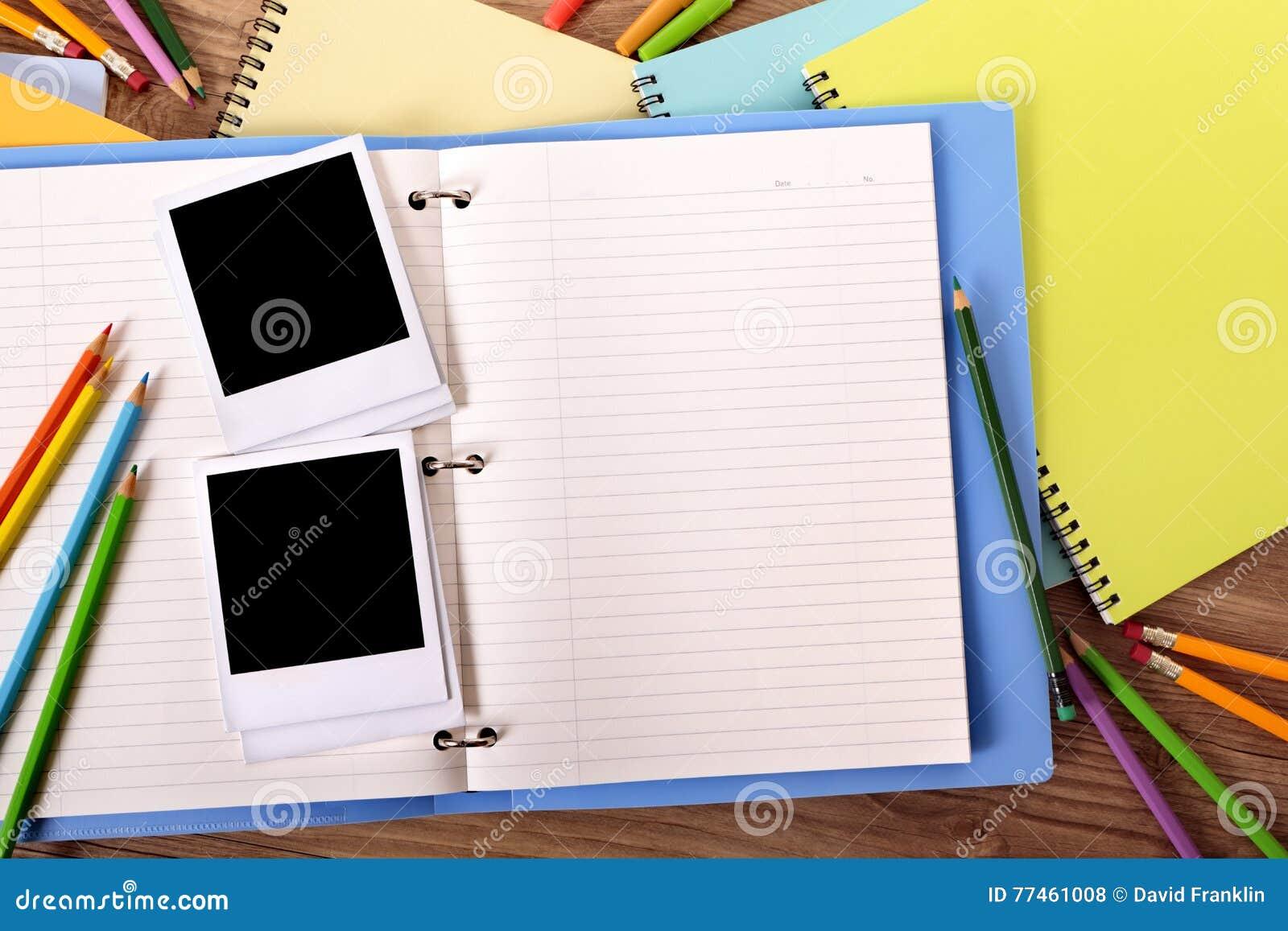 Photo album open with several blank polaroid style photo print frame