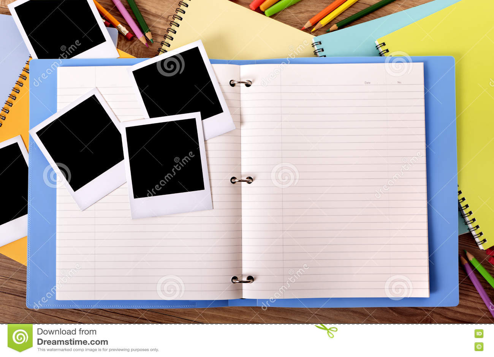 Photo album open with several blank polaroid style photo print frames