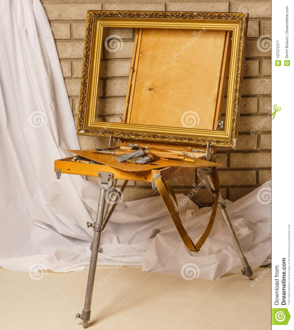 Photo of Artist tool box. Painter`s case with portable easel. Th