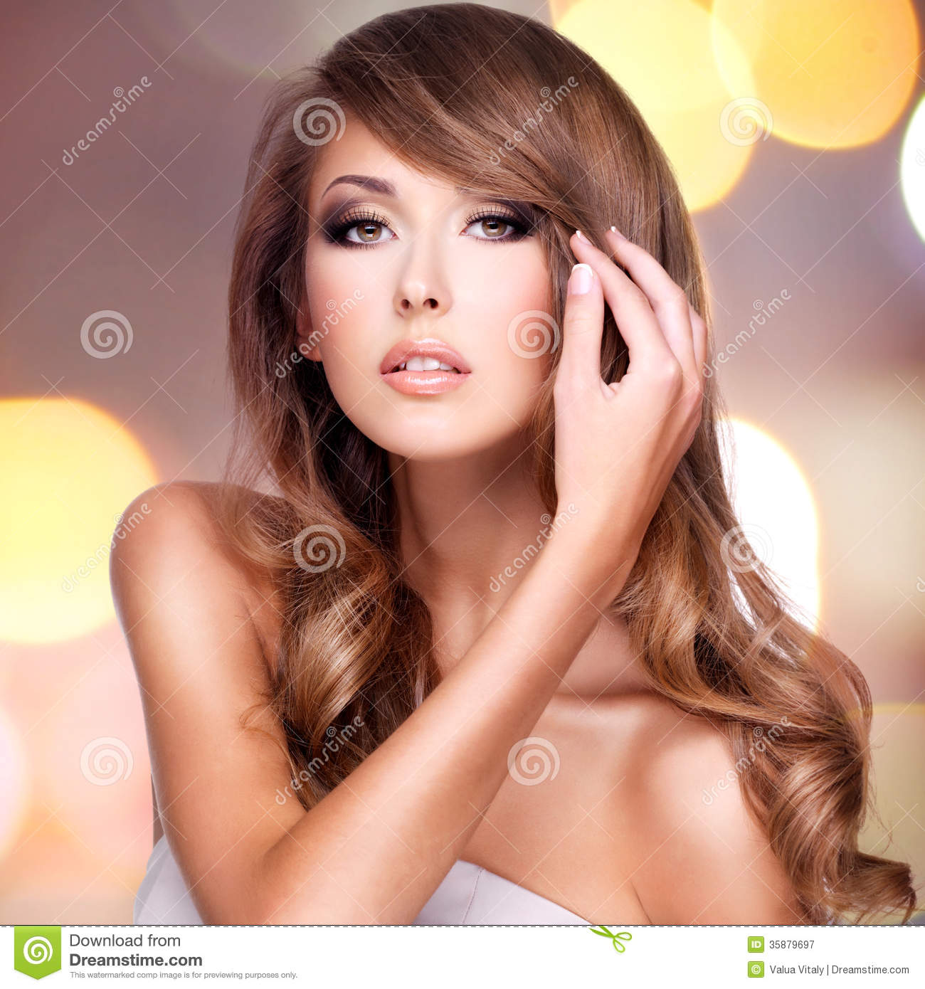 Photo Of An Attractive Woman Touching Her Beautiful Hair Stock Image - Image: 35879697