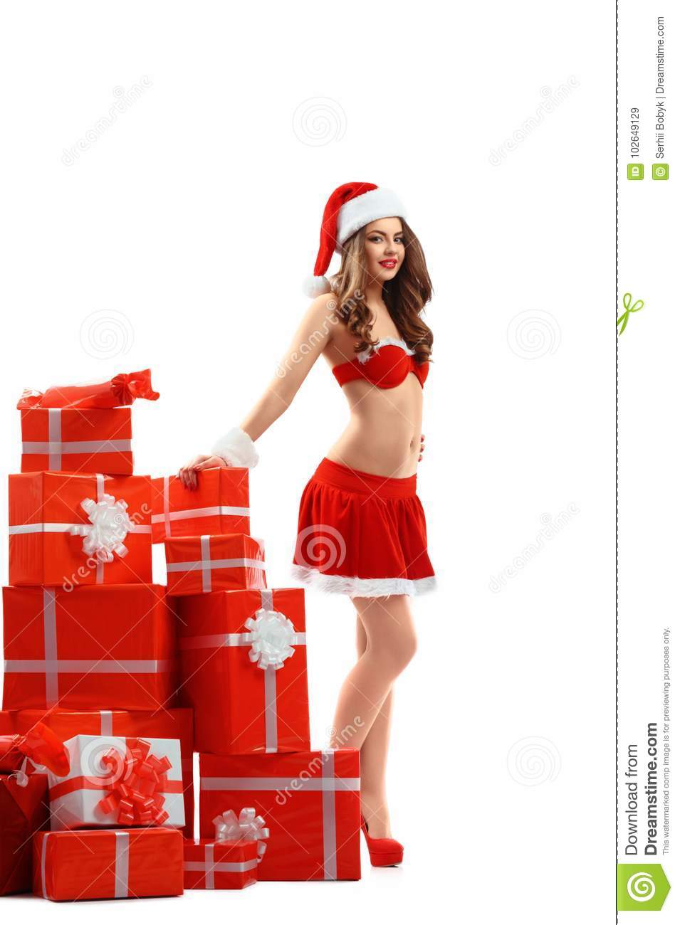 Beautiful Woman In Red Suit Of Santa Claus With Gifts For New Year ...