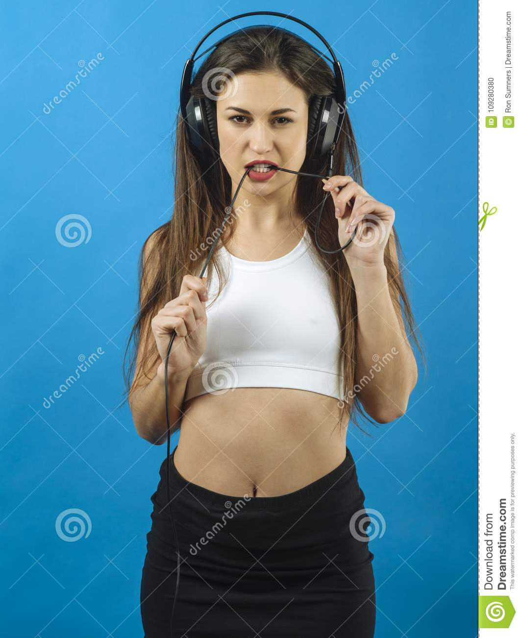 fun woman listening to music with headphones