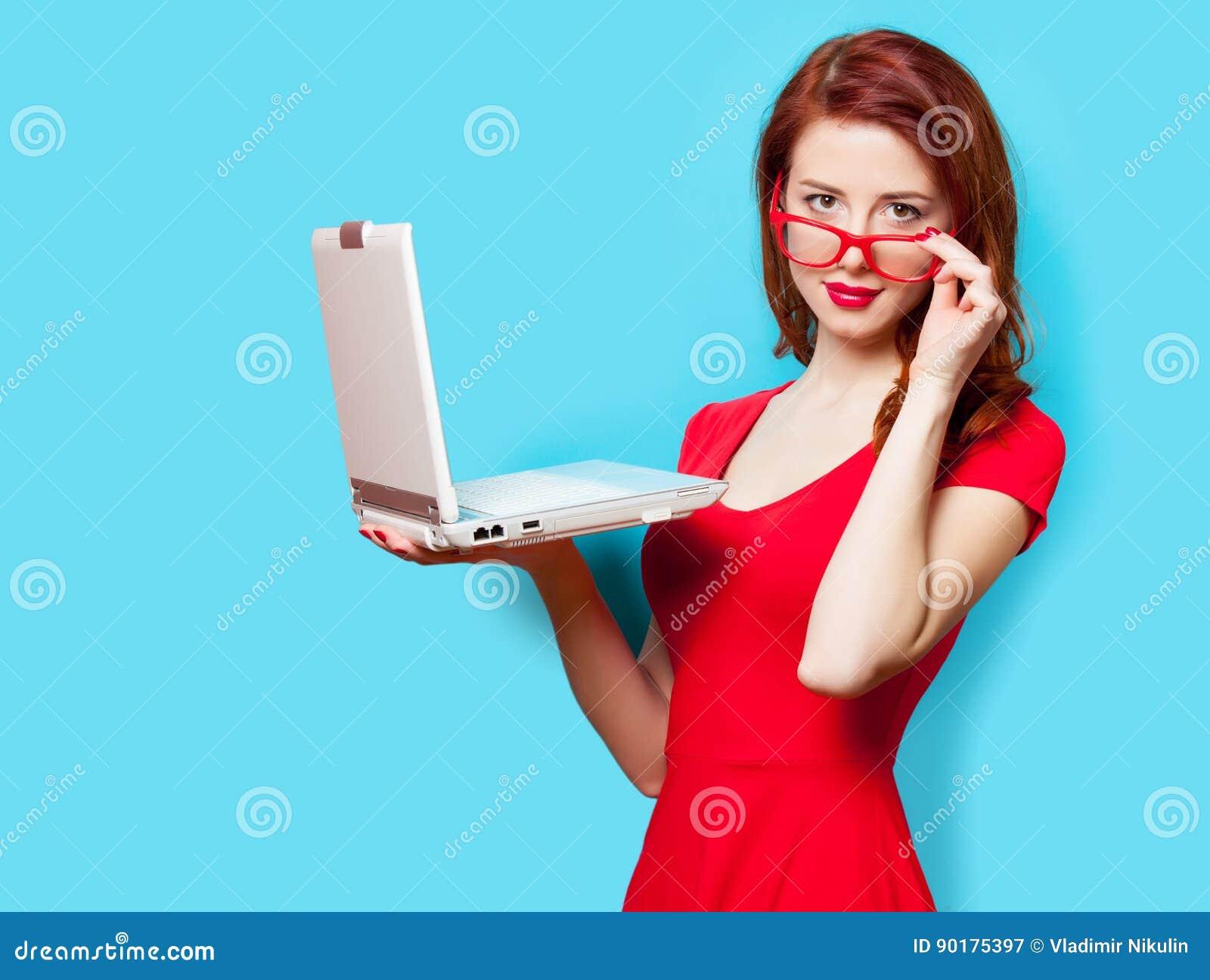 Photo of beautiful young woman holding laptop on the wonderful b