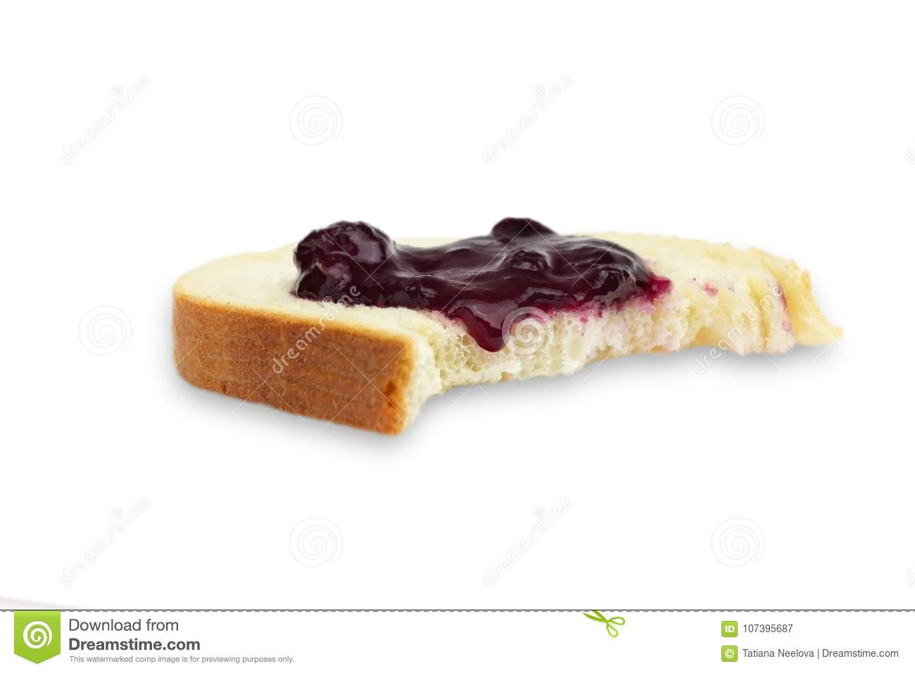 A photo of the bite out of a slice of white wheat bread with the sweet blueberry, bilberry jam or confiture. Isolated on white bac