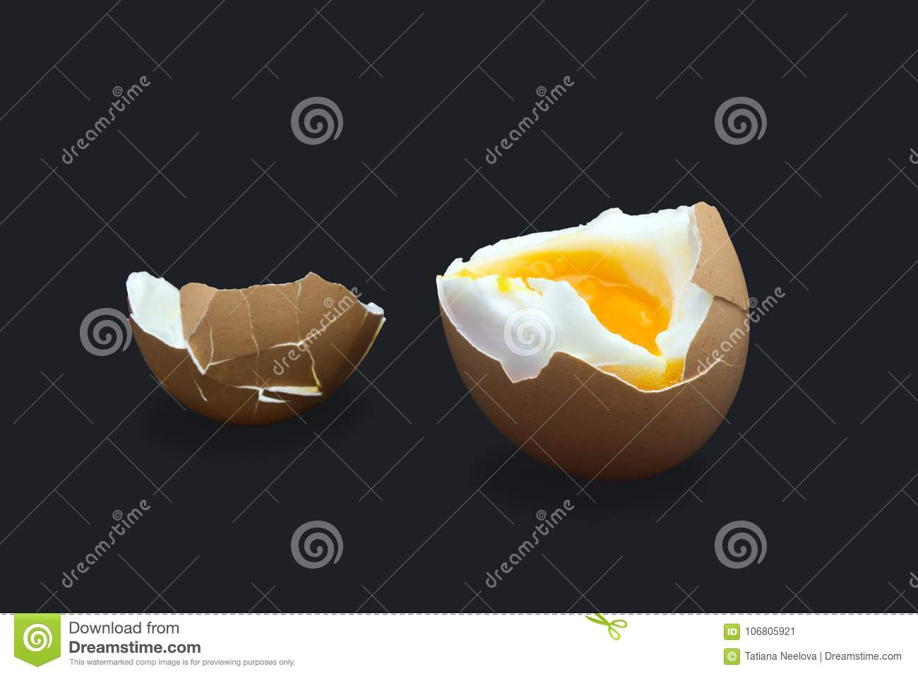 A photo of boiled smash broken hen beige egg isolated on dark blue. Egg`s liquid yolk photo, bright contrast.