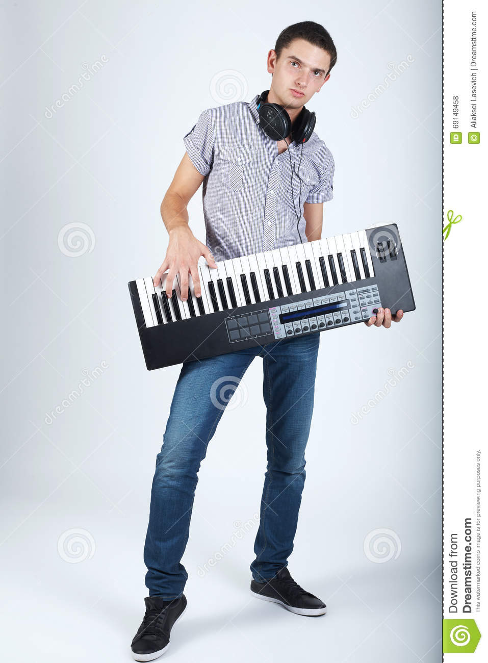 Photo of boy with piano