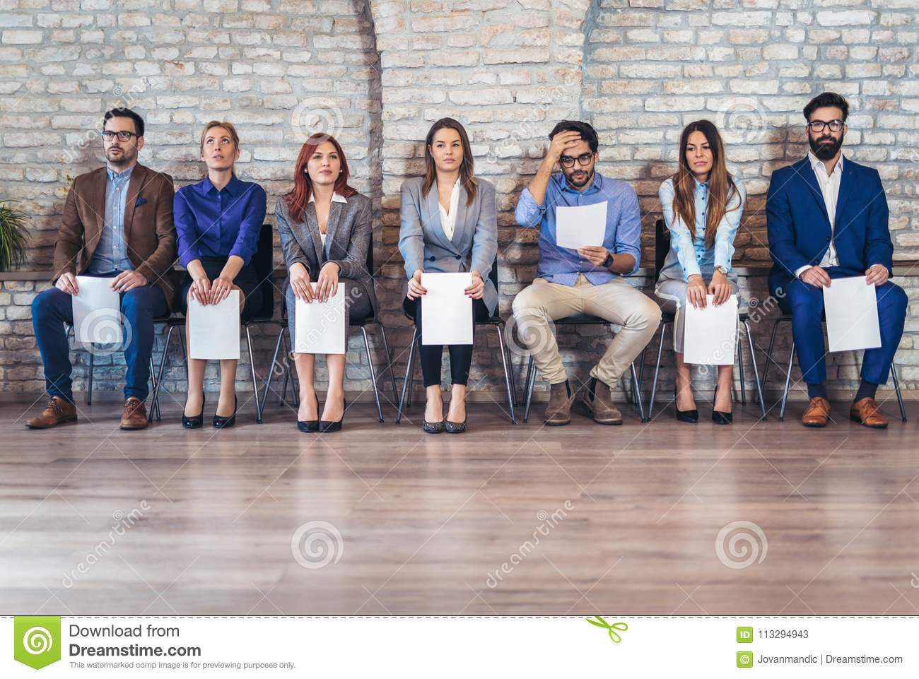 Photo of candidates waiting for a job interview