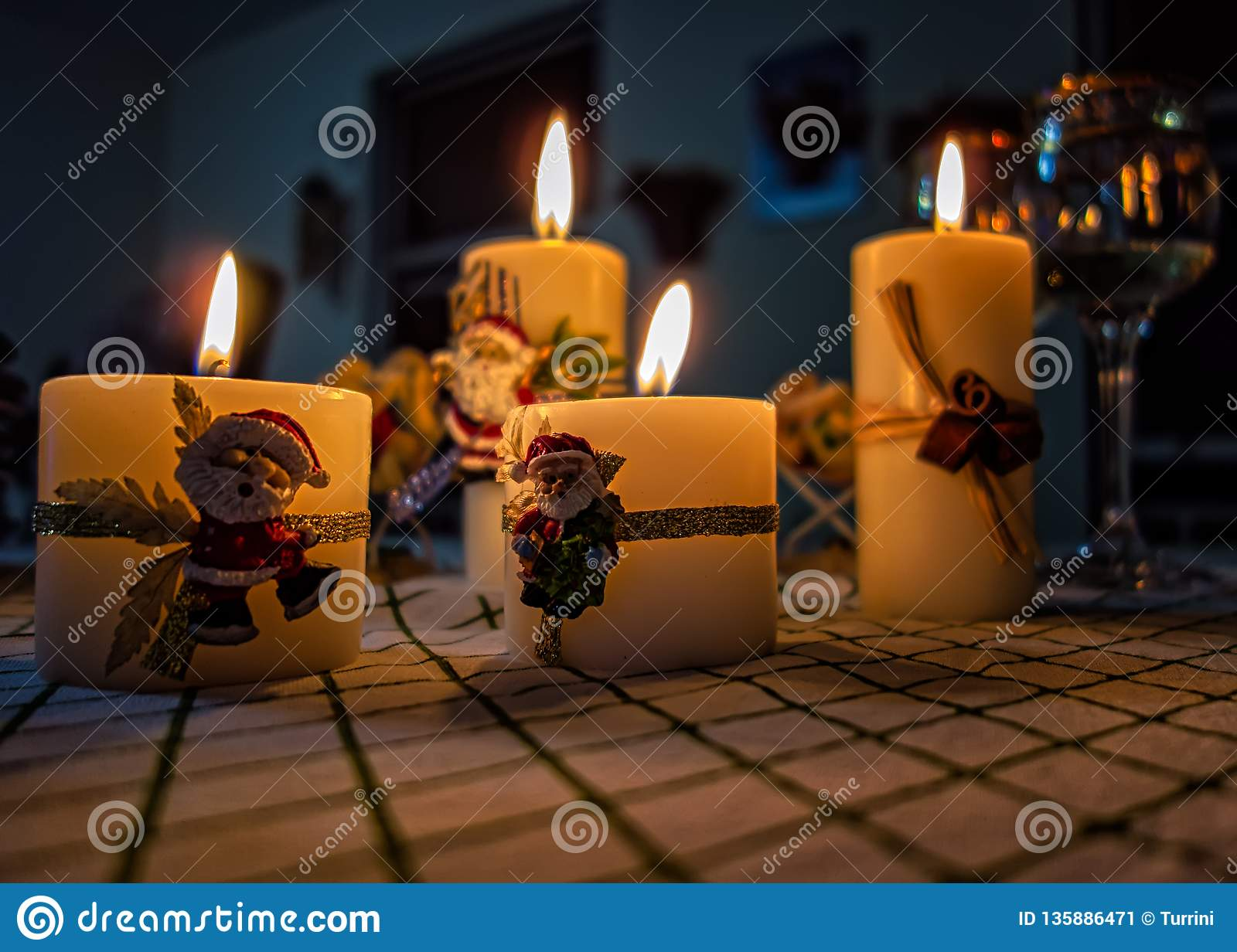 Christmas Candles With Santa Ornament And White Wine Glass Bowls On The Side Stock Image Image Of Bowls December 135886471