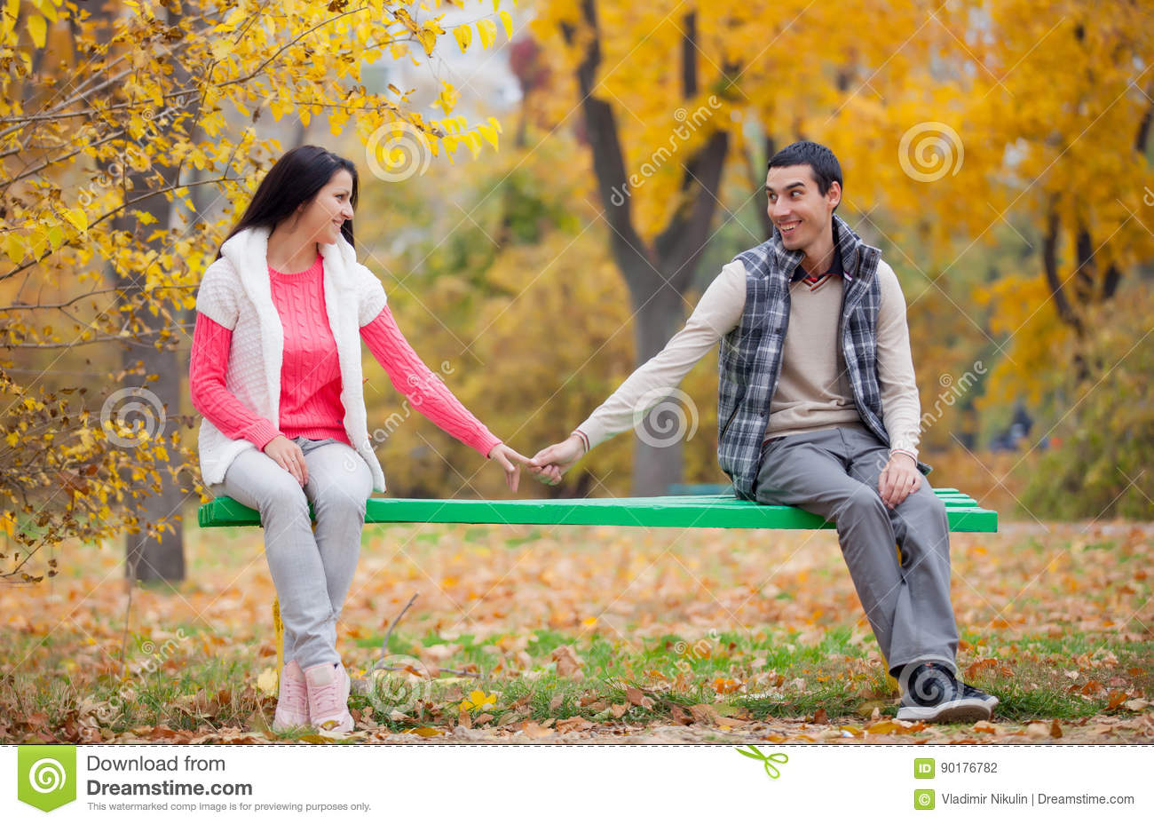 Photo Of Cute Couple Sitting On The Bench And Holding Hands T