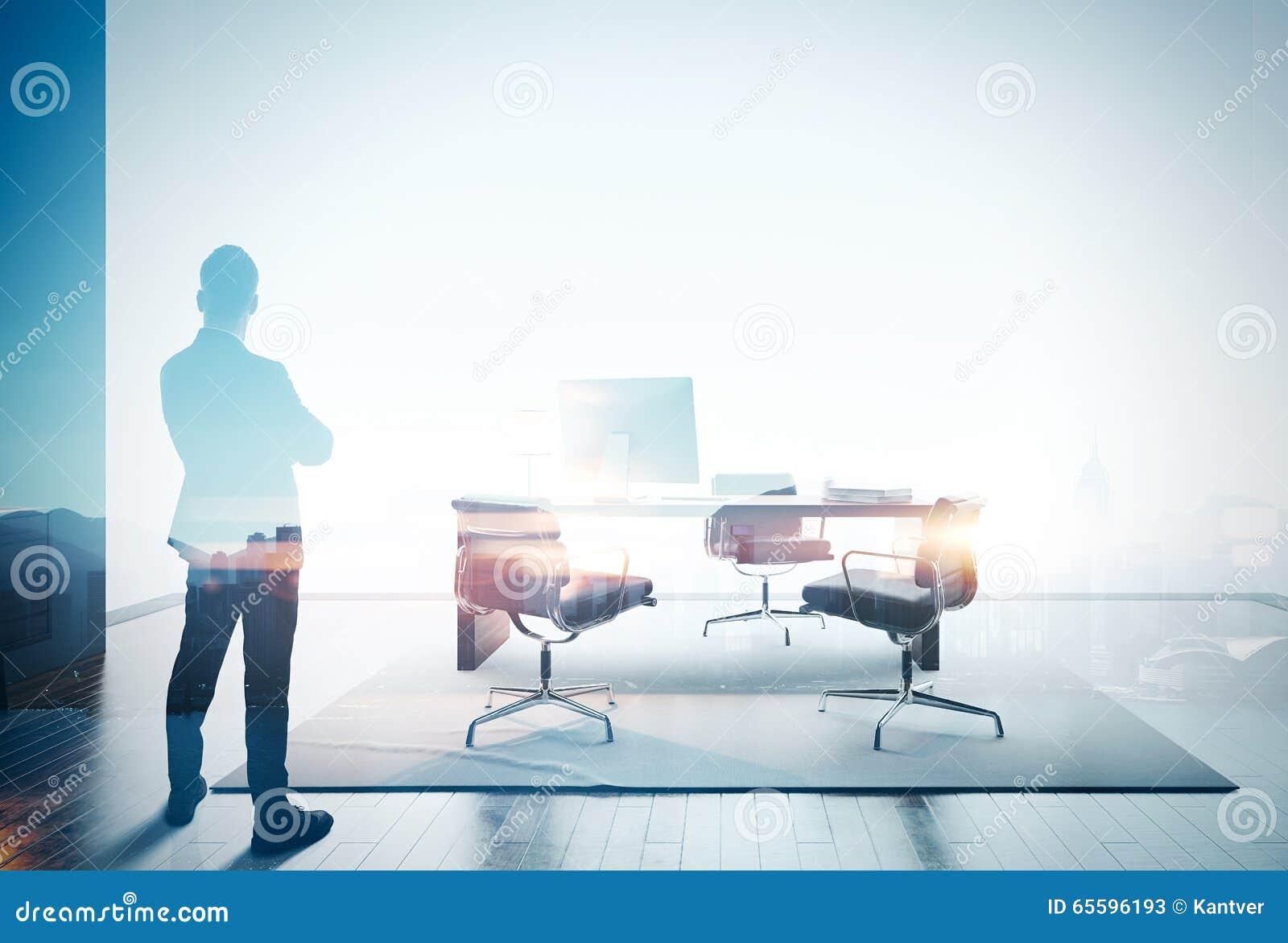 Photo de double exposition d homme d affaires dans le bureau