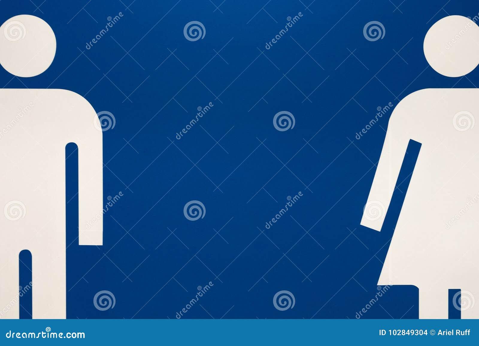 Man and woman symbols indicating designated bathrooms