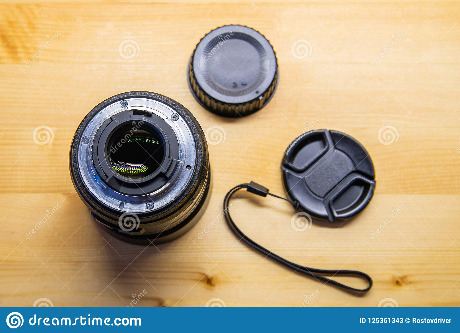 Photo DSLR Camera or Video lens close-up on wooden background, objective, concept of photographer camera man job, looking for a ph