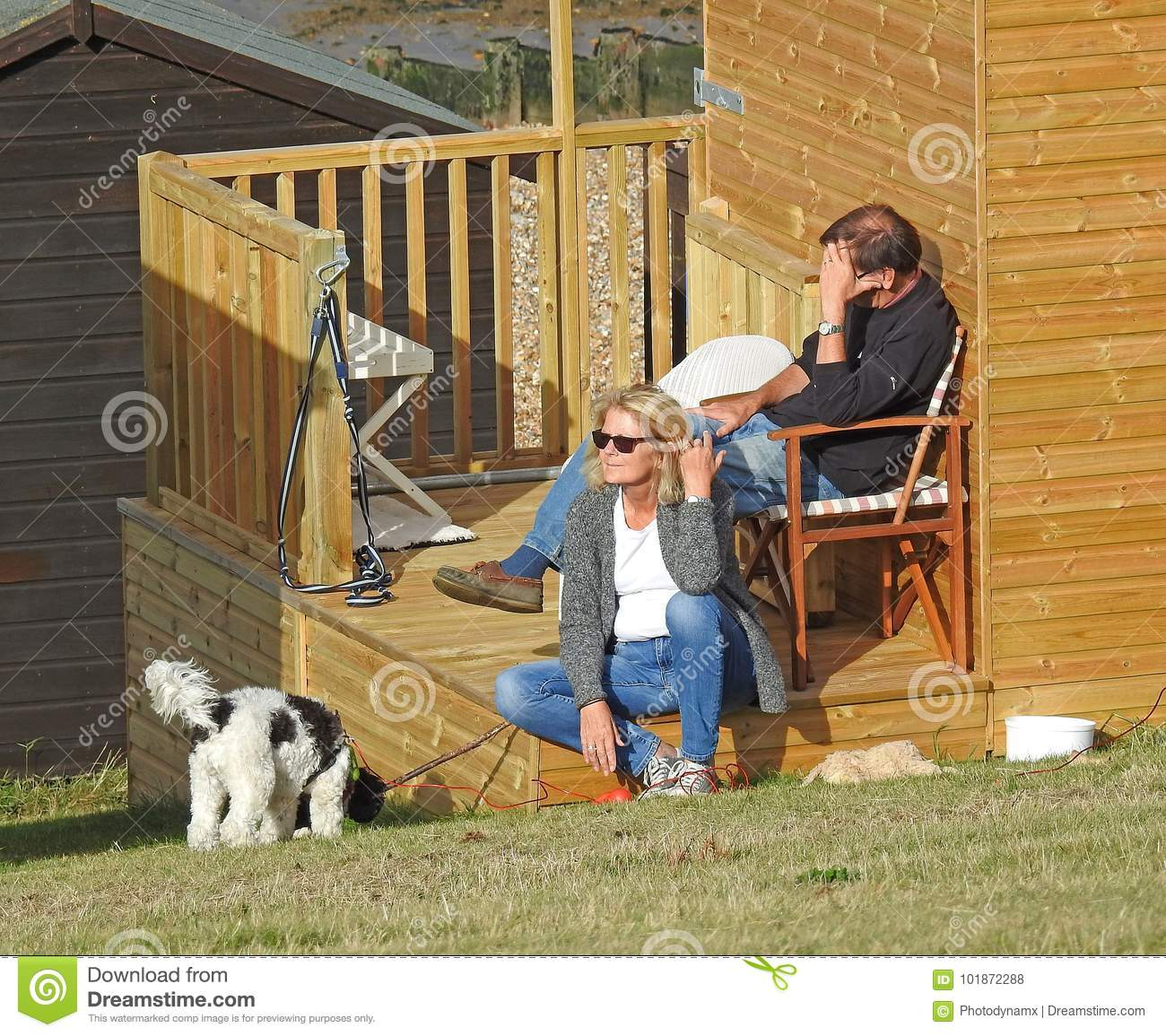 Couple Enjoying Their Summer Holidays Stock Photo: Beach Hut Holidaymakers Editorial Stock Photo. Image Of