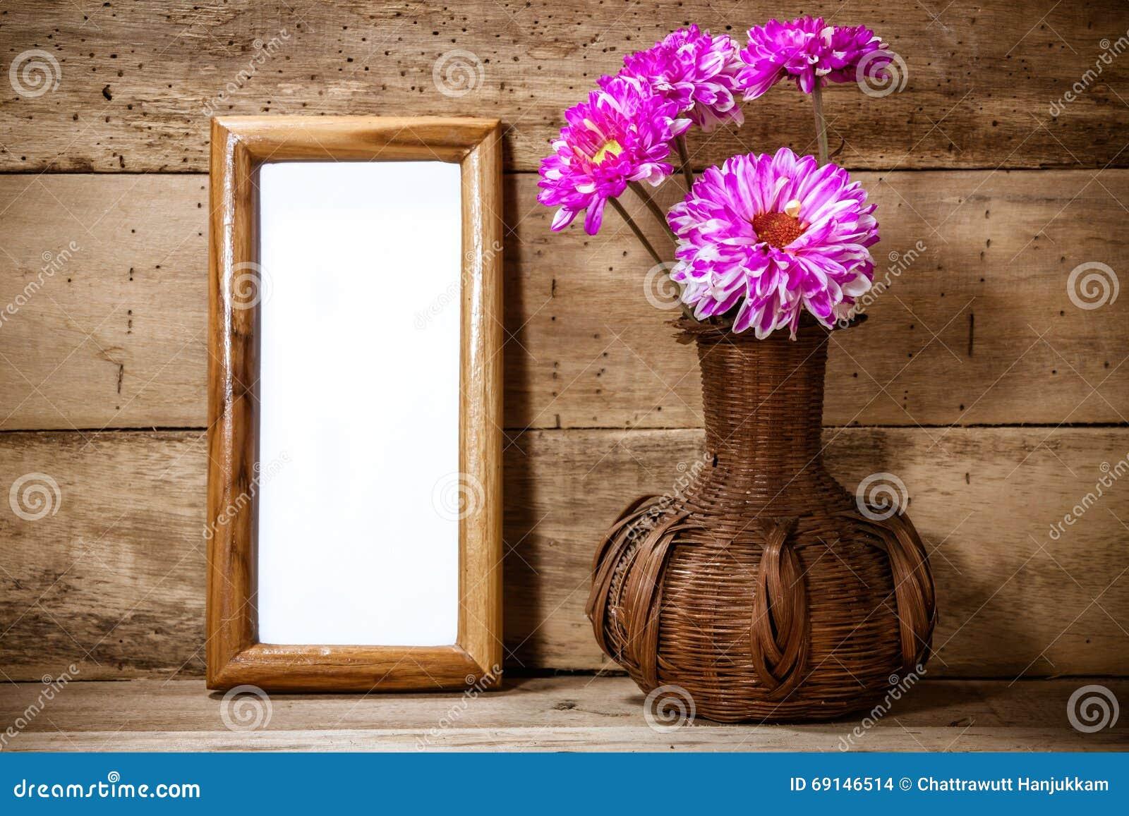Photo framebeautiful pink flower in vase on wood background photo framebeautiful pink flower in vase on wood background floridaeventfo Images