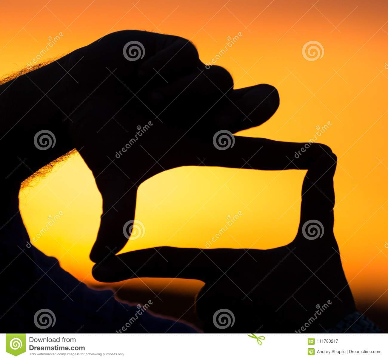 Photo frame silhouette at sunset