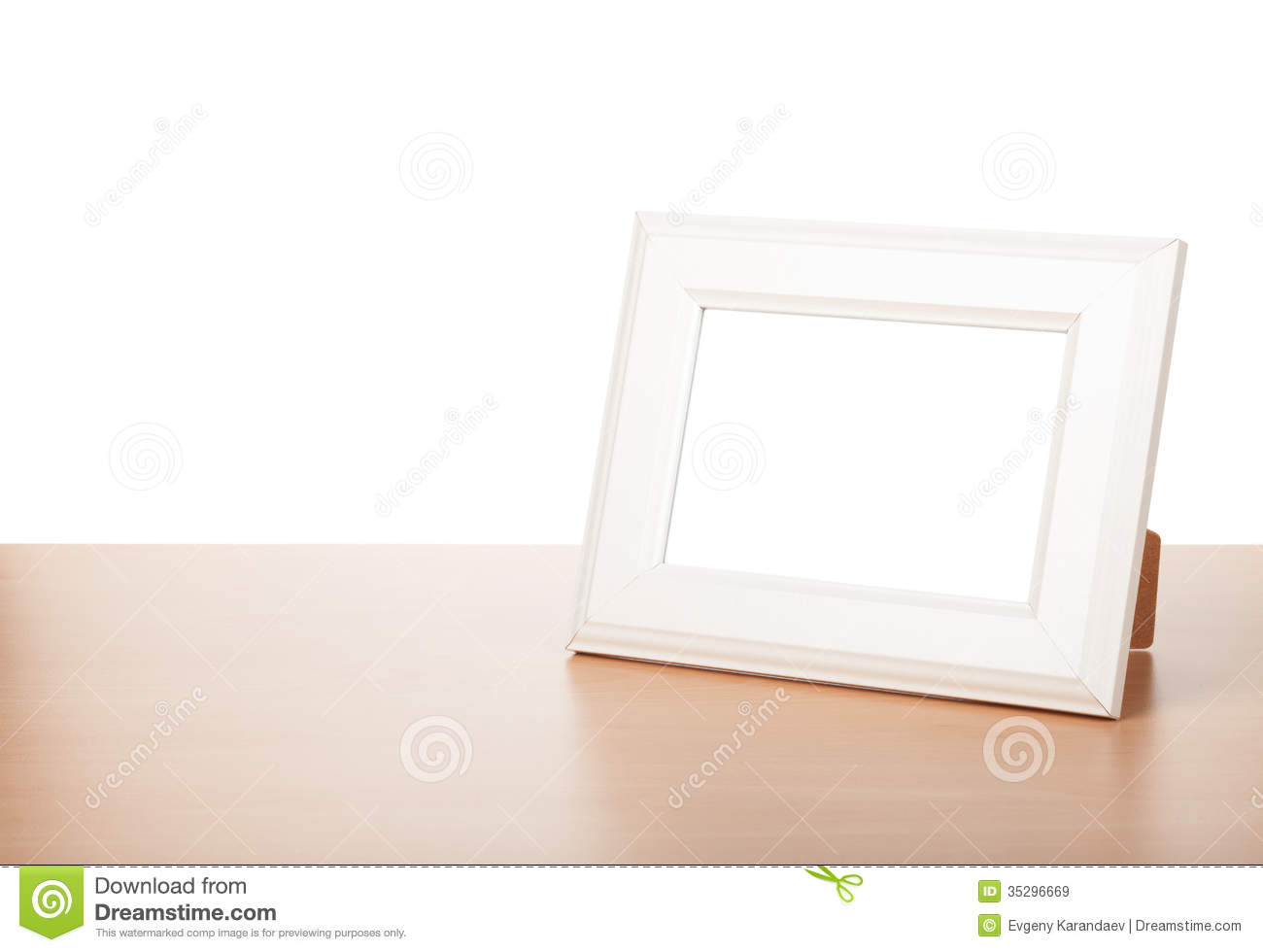 Photo frame on wood table royalty free stock images for How to display picture frames on a table