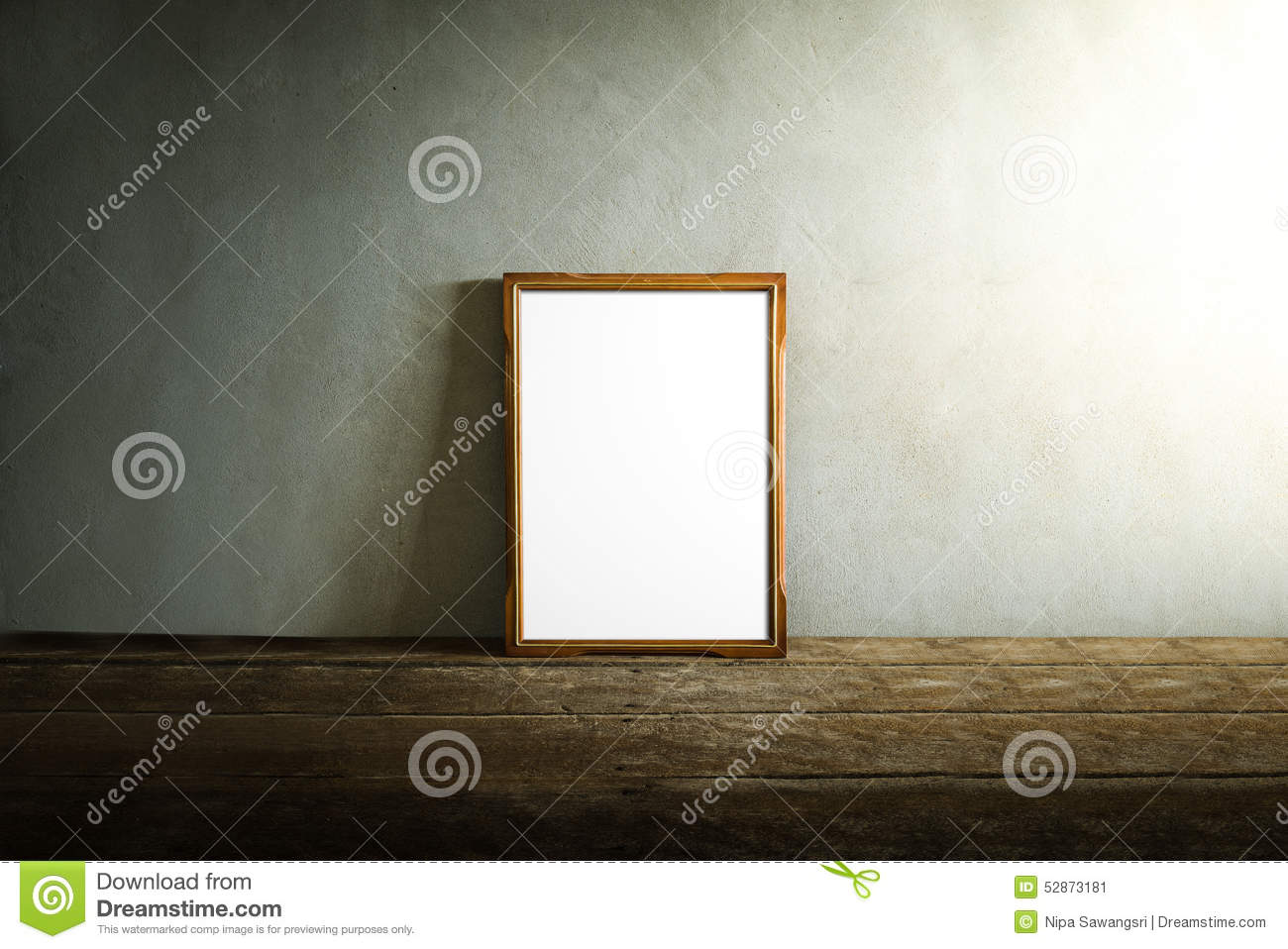 Photo frame on wooden table over grunge background