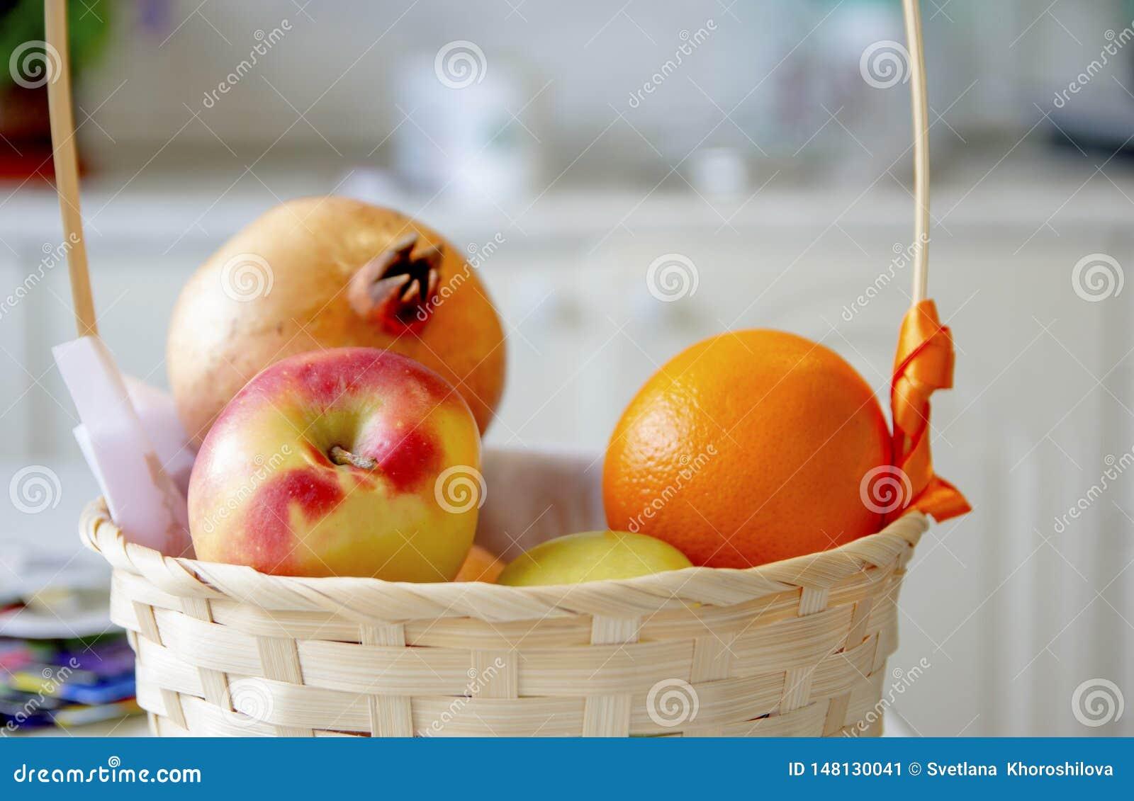 Fruits lie in a wicker basket in the bright kitchen