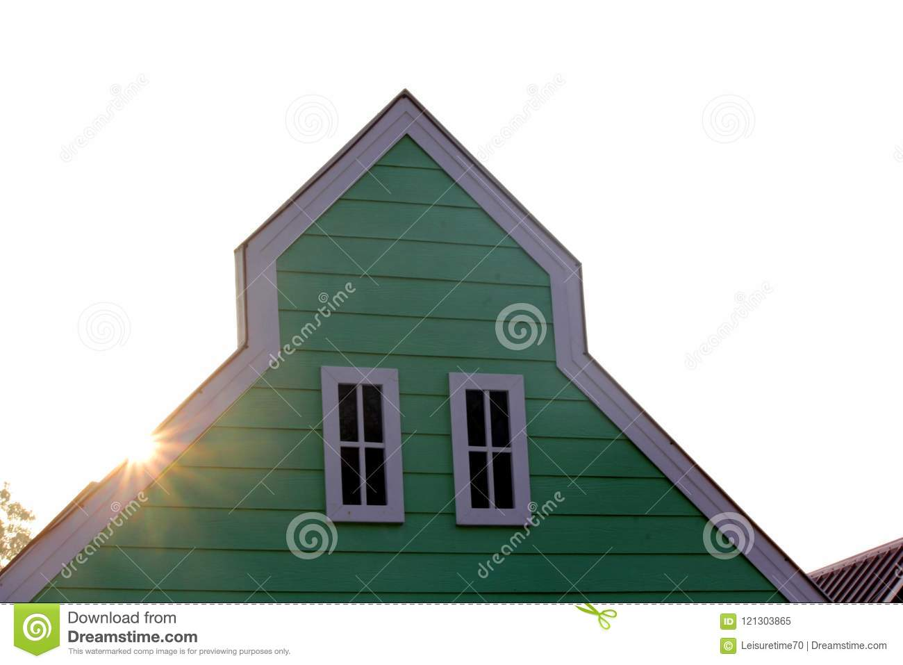 Gable roof with white windows on wooden house