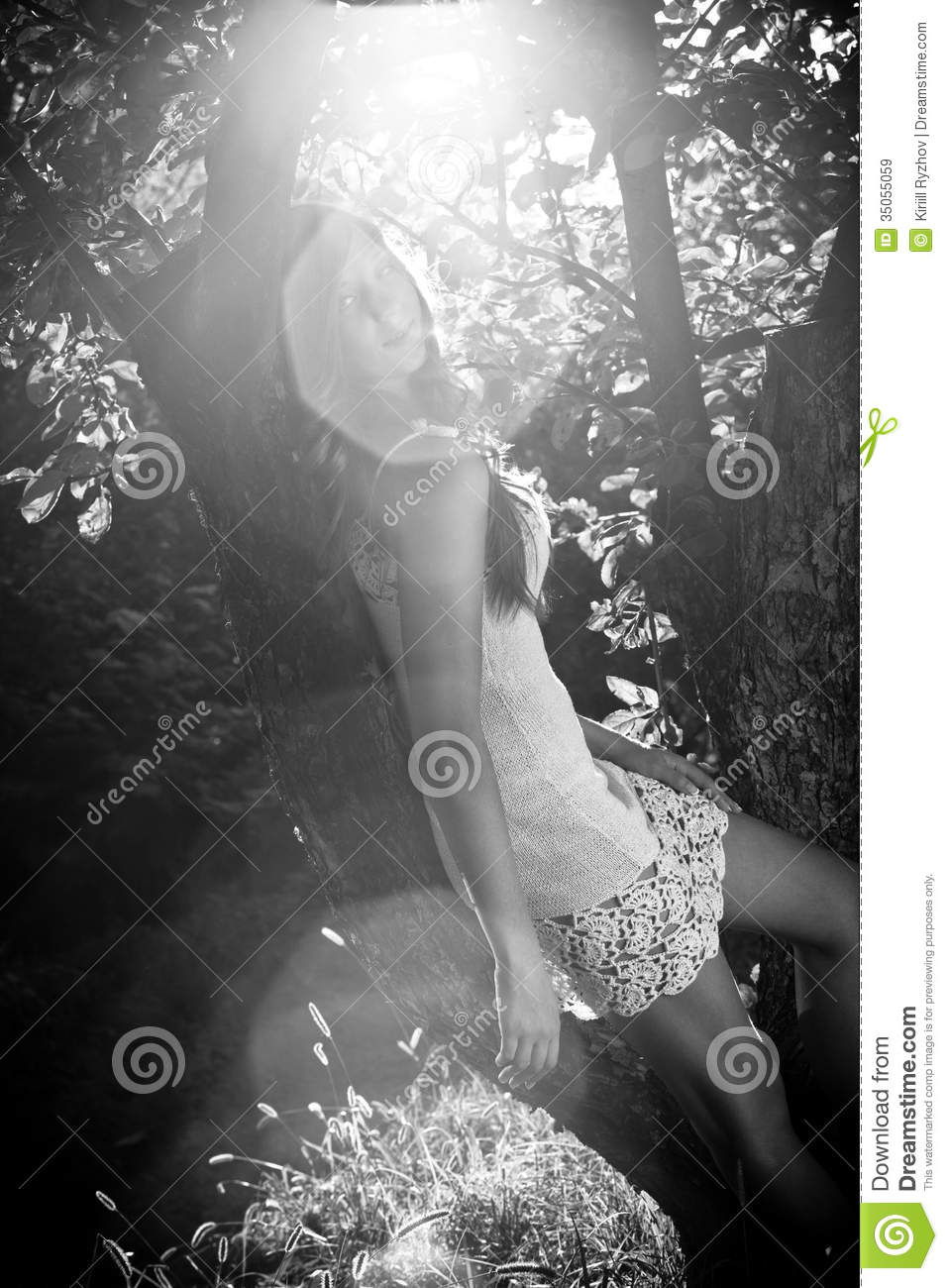 Photo Of Girl Leaning To Tree In Sun Rays Stock Image